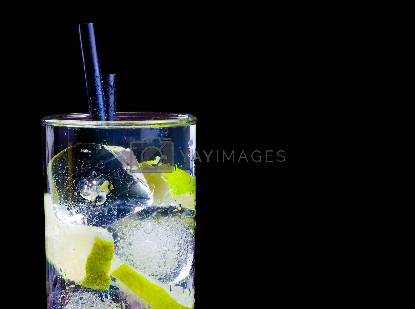 Cocktail with ice and lime slice isolated and space for text by donfiore