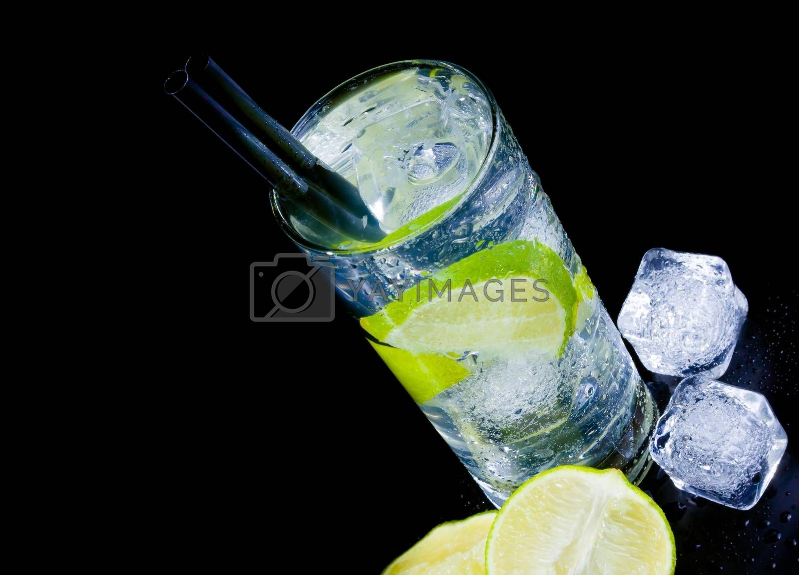 top of view of cocktail with ice and lime slice with straw and space for text by donfiore