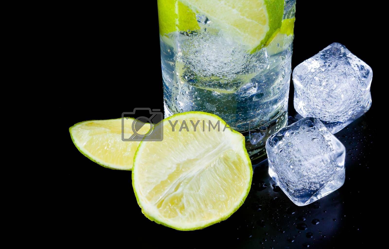 detail of cocktail with ice and lime slice and space for text by donfiore