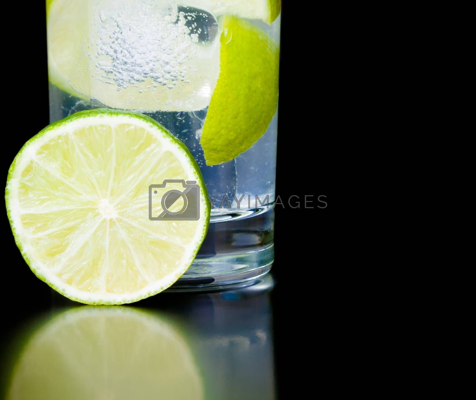 lime slice near cocktail and space for text by donfiore
