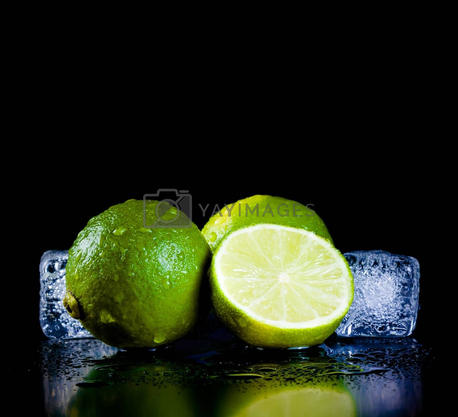 fresh lime with ice cubes with space for text by donfiore