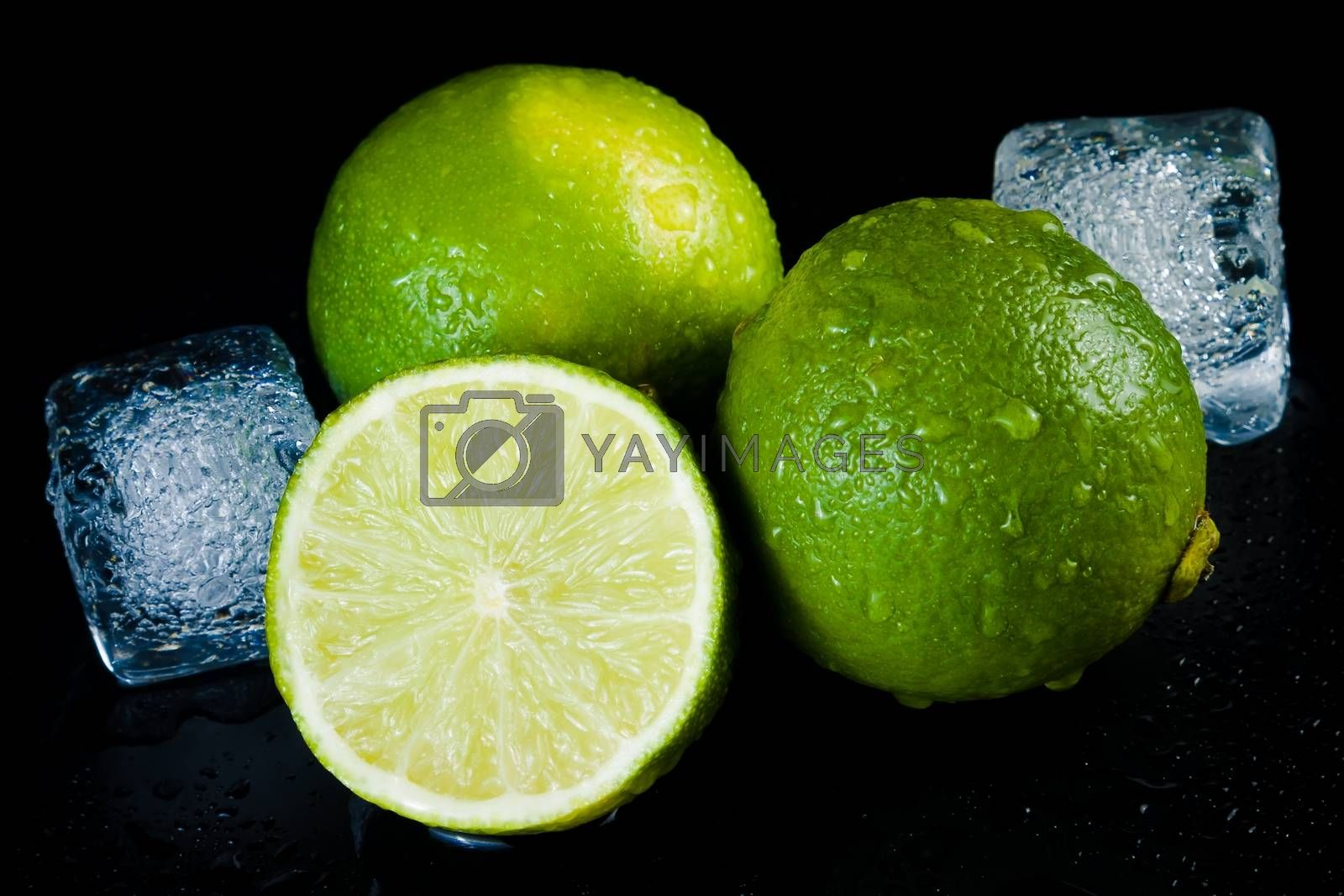 close-up of fresh lime with ice cubes by donfiore