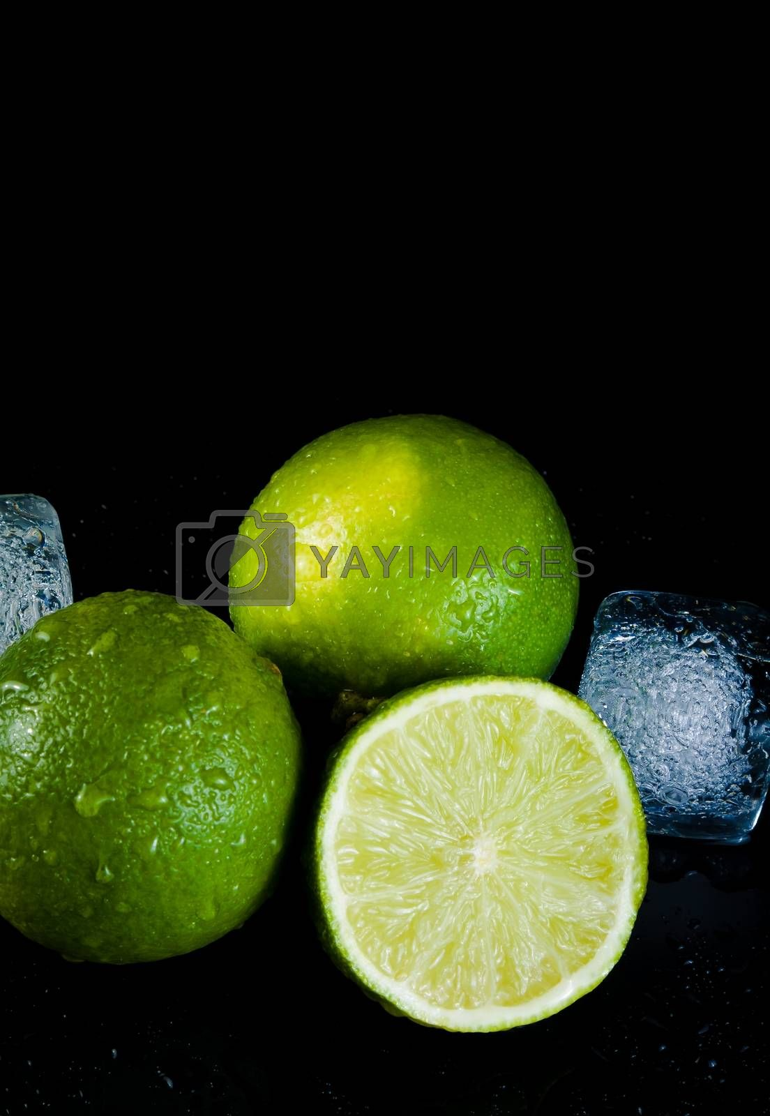 close-up of fresh lime with ice cubes with space for text by donfiore