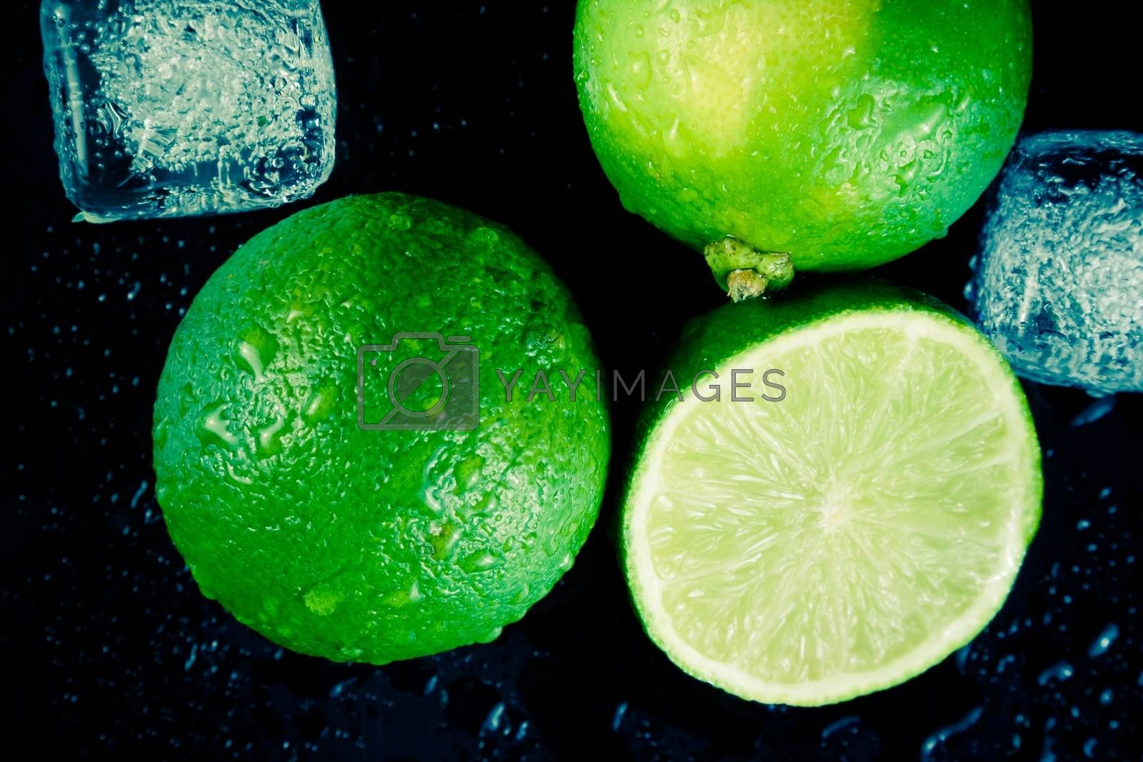 top of view of fresh lime with ice cubes by donfiore