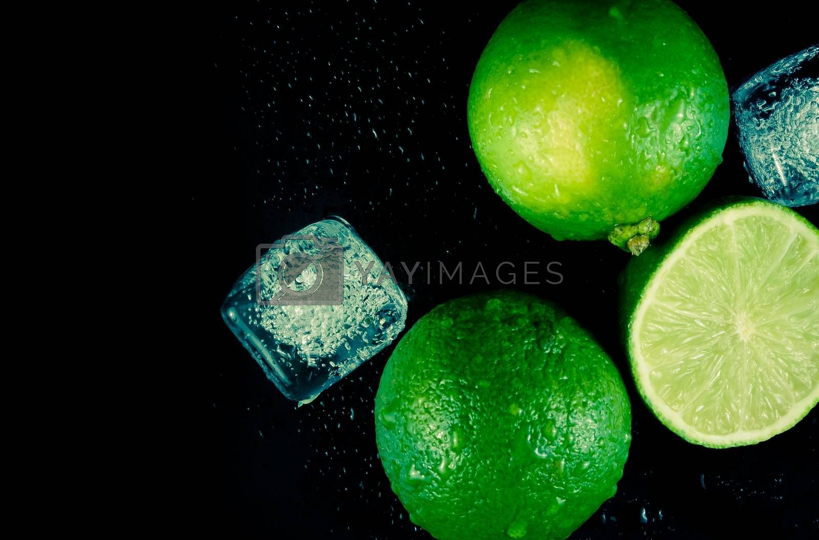 top of view of fresh lime with ice cubes and space for text by donfiore