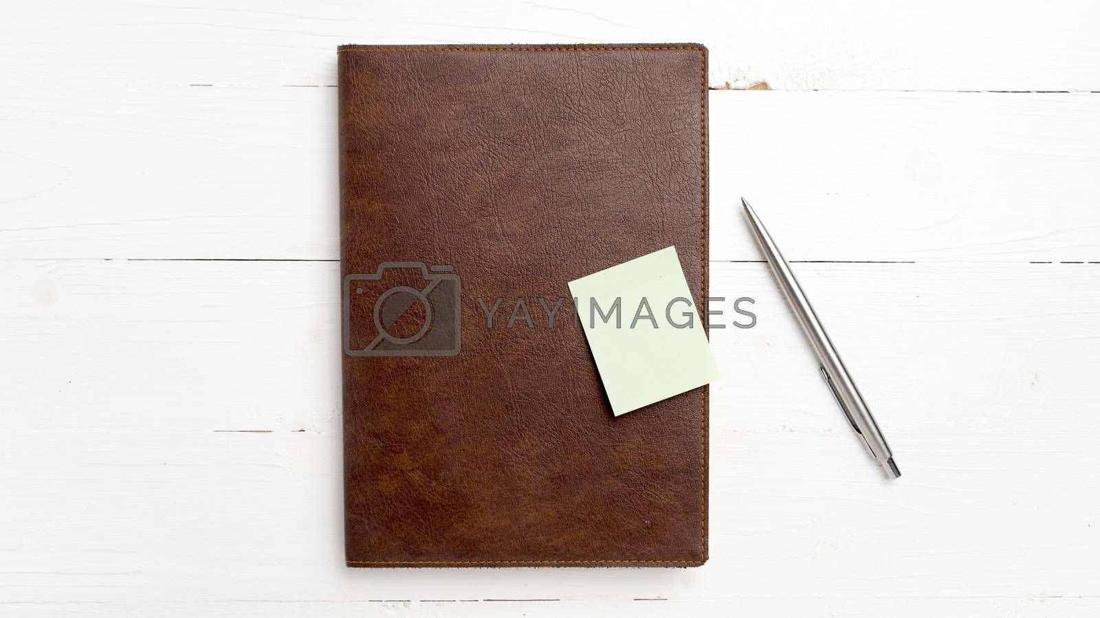 brown notebook and pen by ammza12