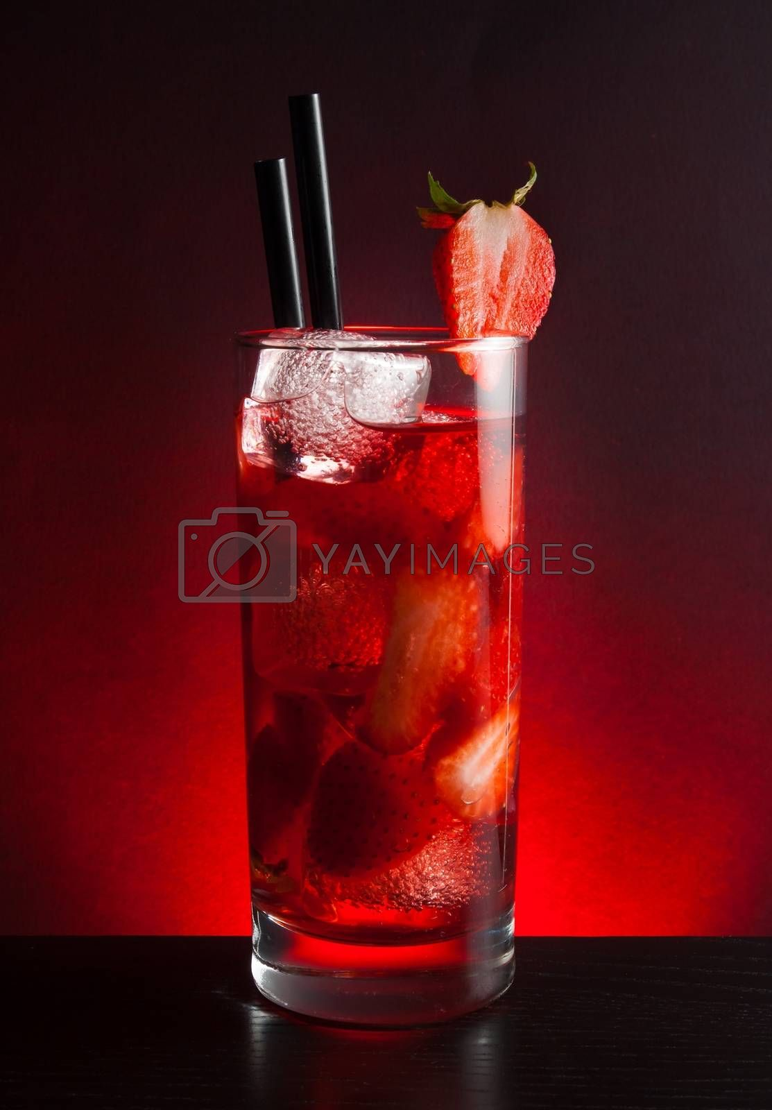 Strawberry cocktail with ice on black table  by donfiore