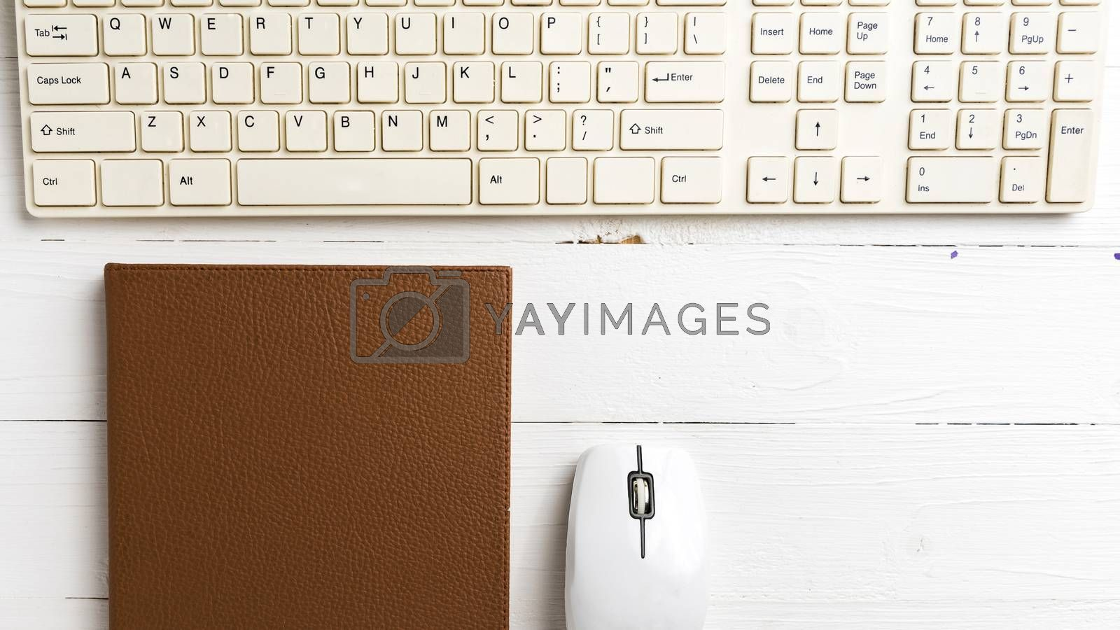 computer and brown notebook with office supplies  by ammza12