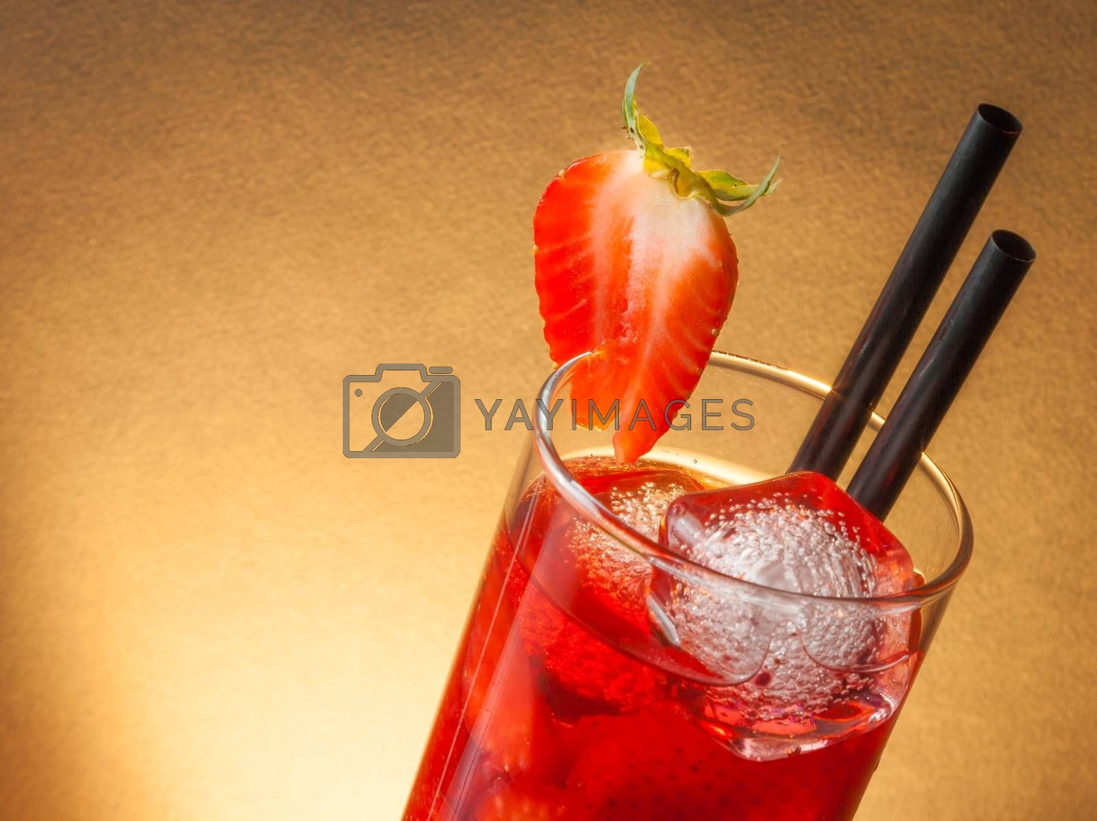 detail of strawberry cocktail with ice and space for text by donfiore