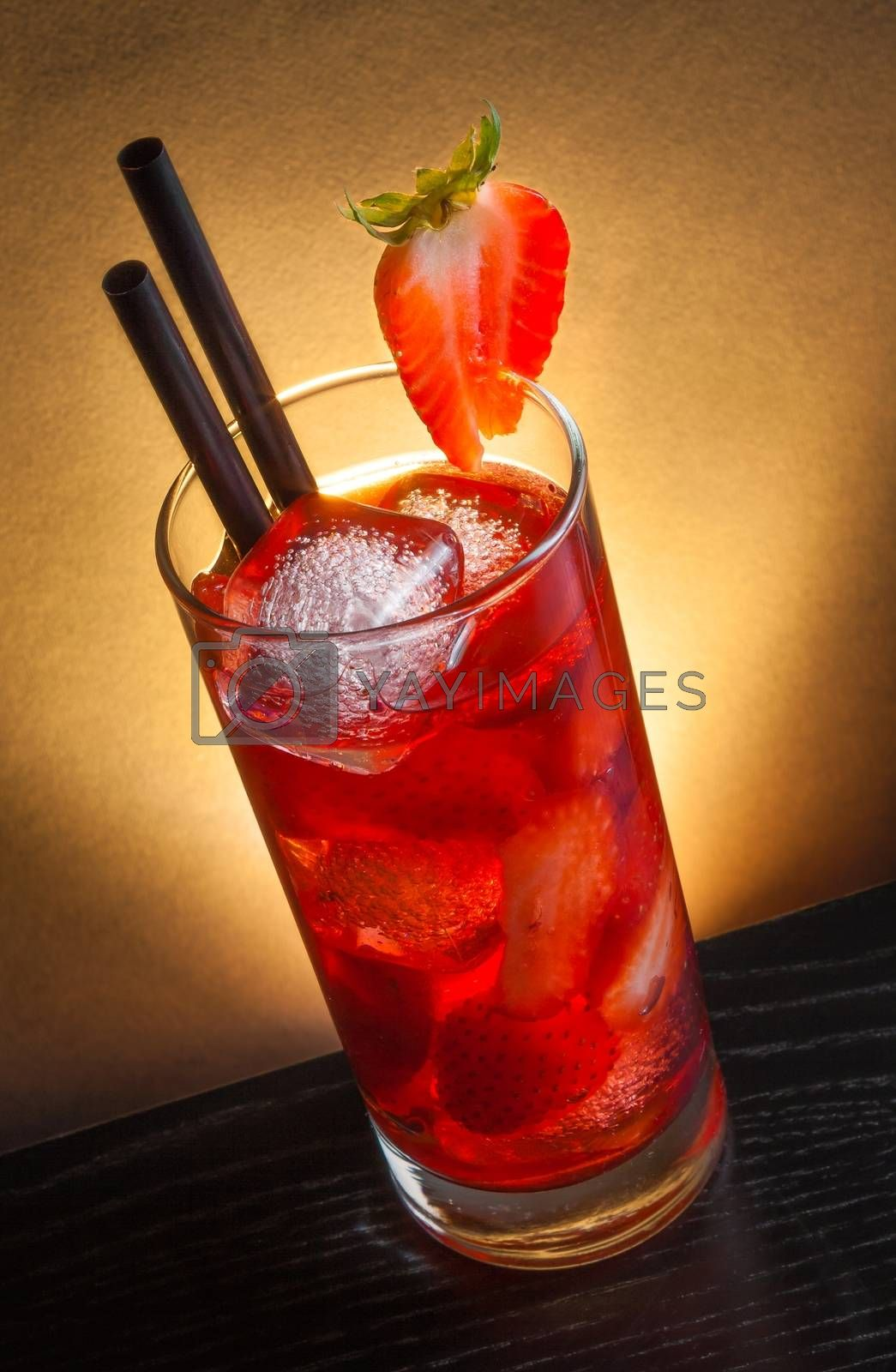Strawberry cocktail with ice on wood table  by donfiore