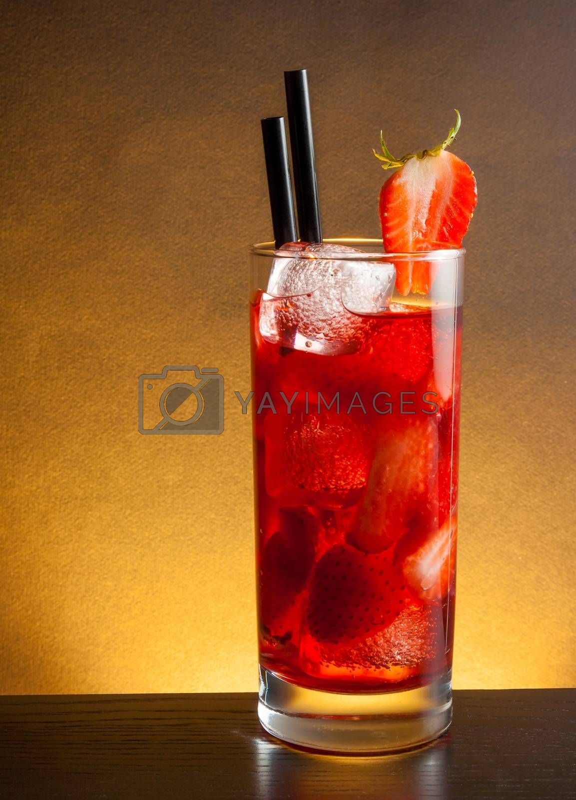 Strawberry cocktail with ice on wood table and space for text by donfiore