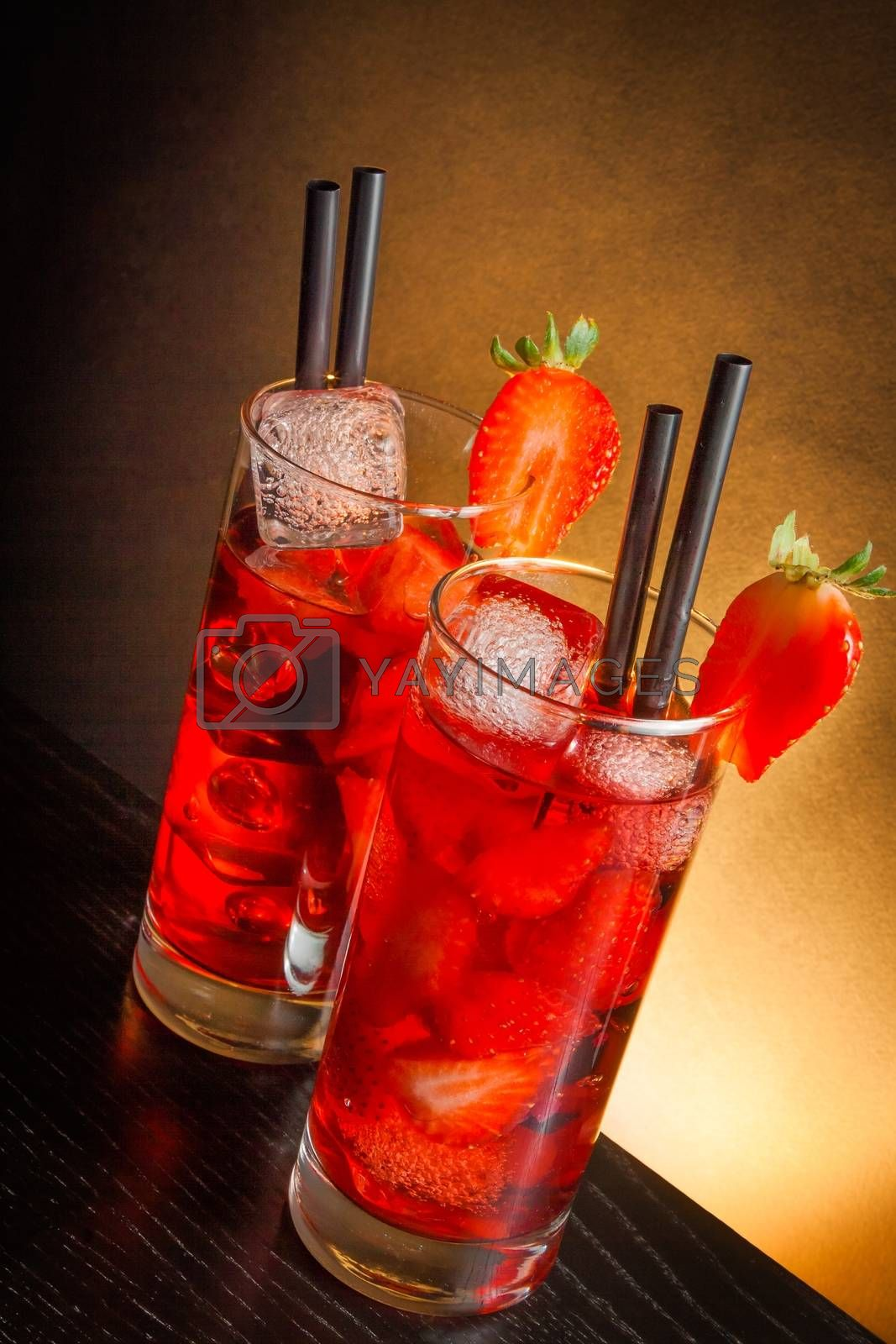 Strawberry cocktail with ice on wood by donfiore