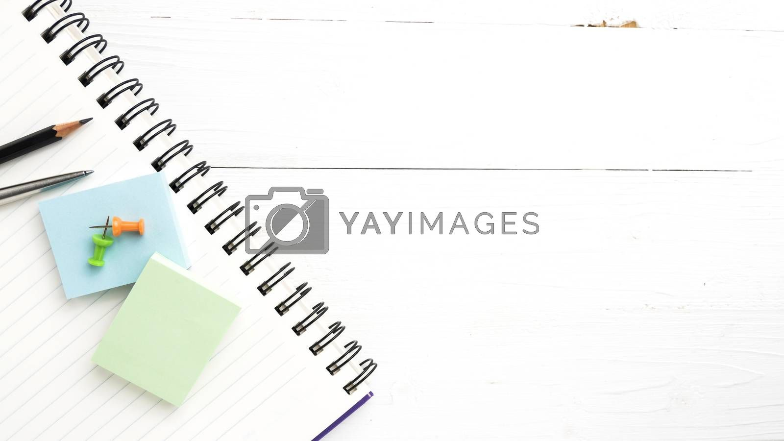 notepad with office supplies view from above by ammza12