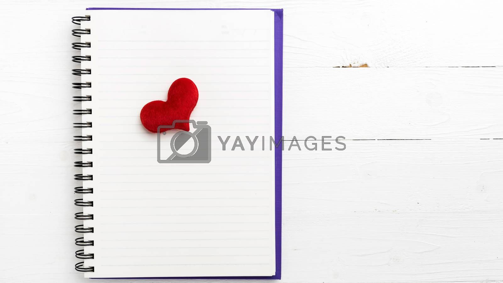 red heart on notepad by ammza12