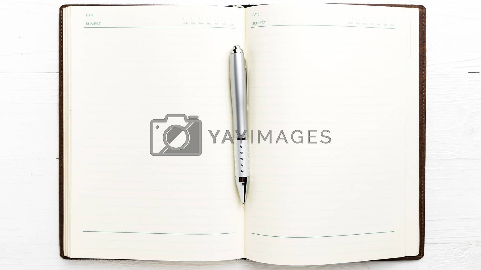 open notebook with pen by ammza12