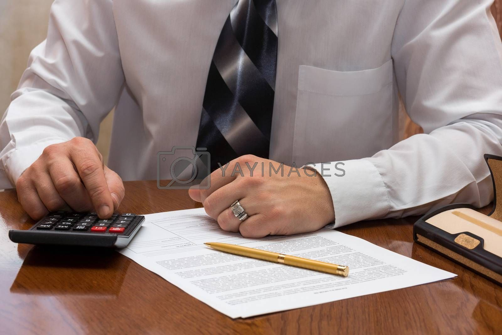 The photograph shows the person who signs the document