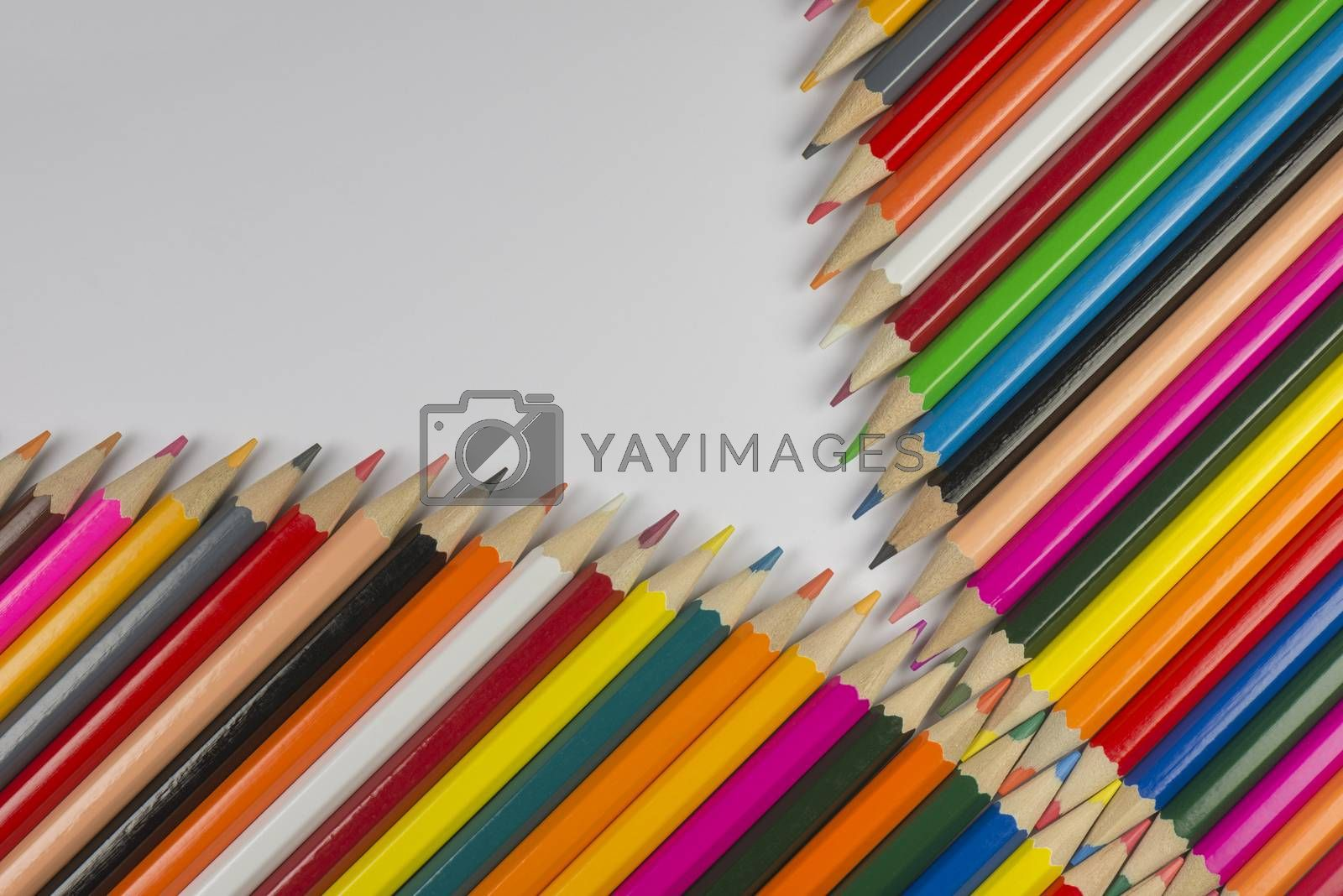 Colorful cedar wooden pencils in zipper shape  by Tofotografie