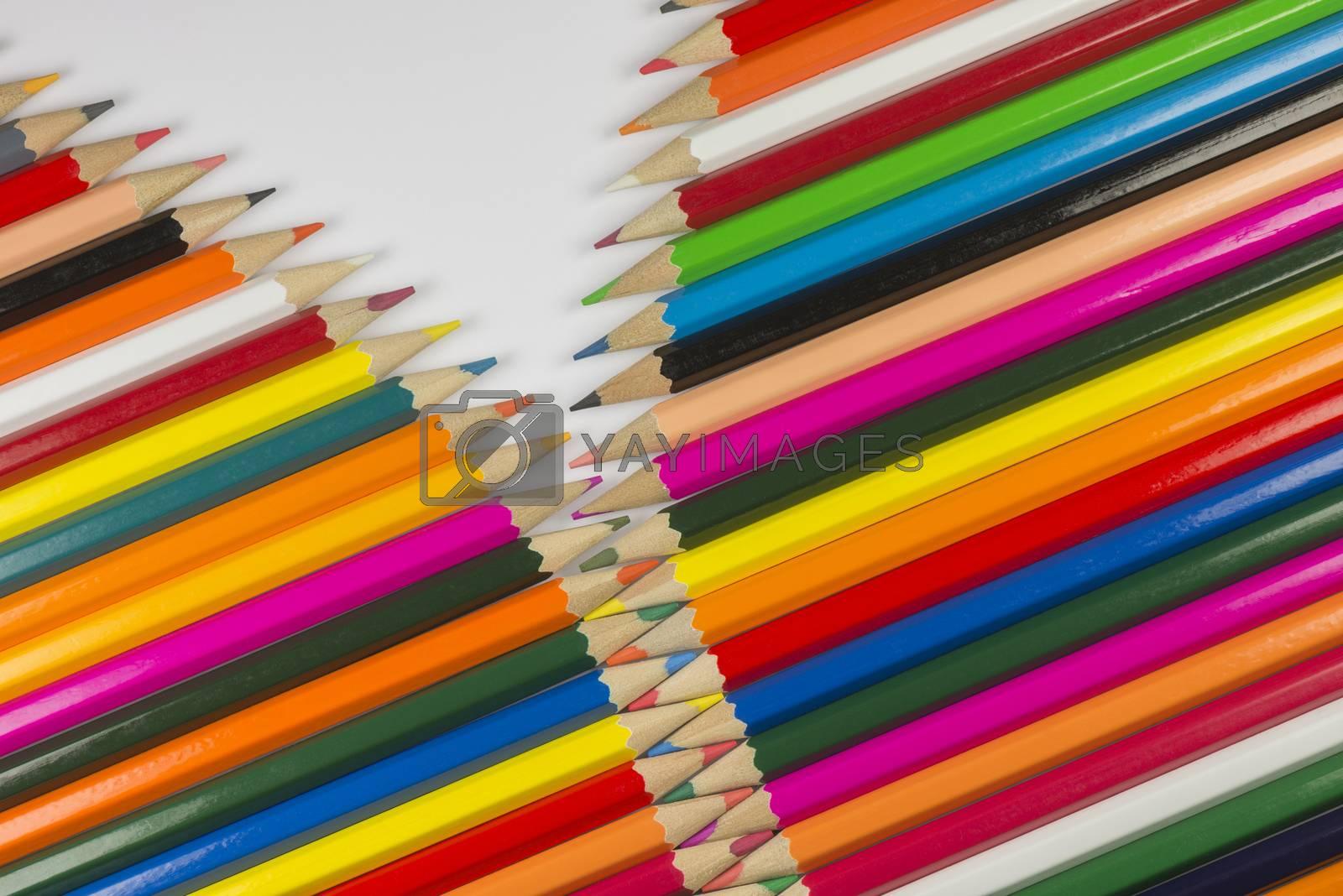 Colorful cedar wooden pencils in zipper shape  by Tofotografie