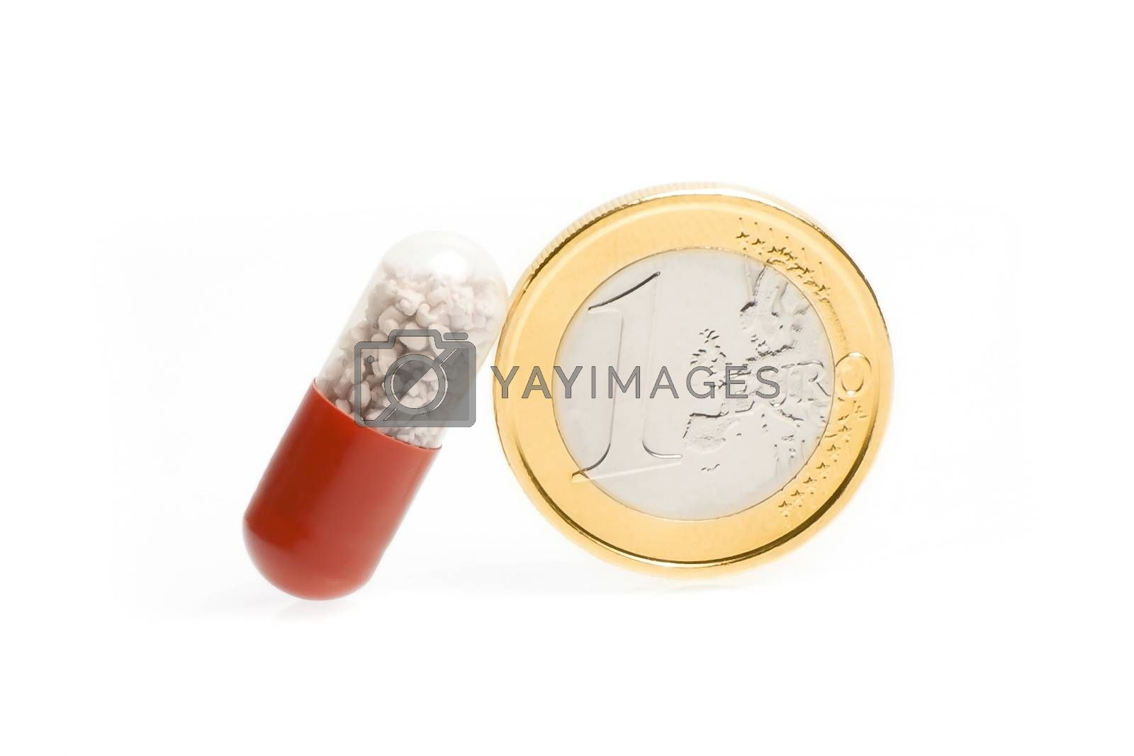 one euro coin and one medical pill on white background