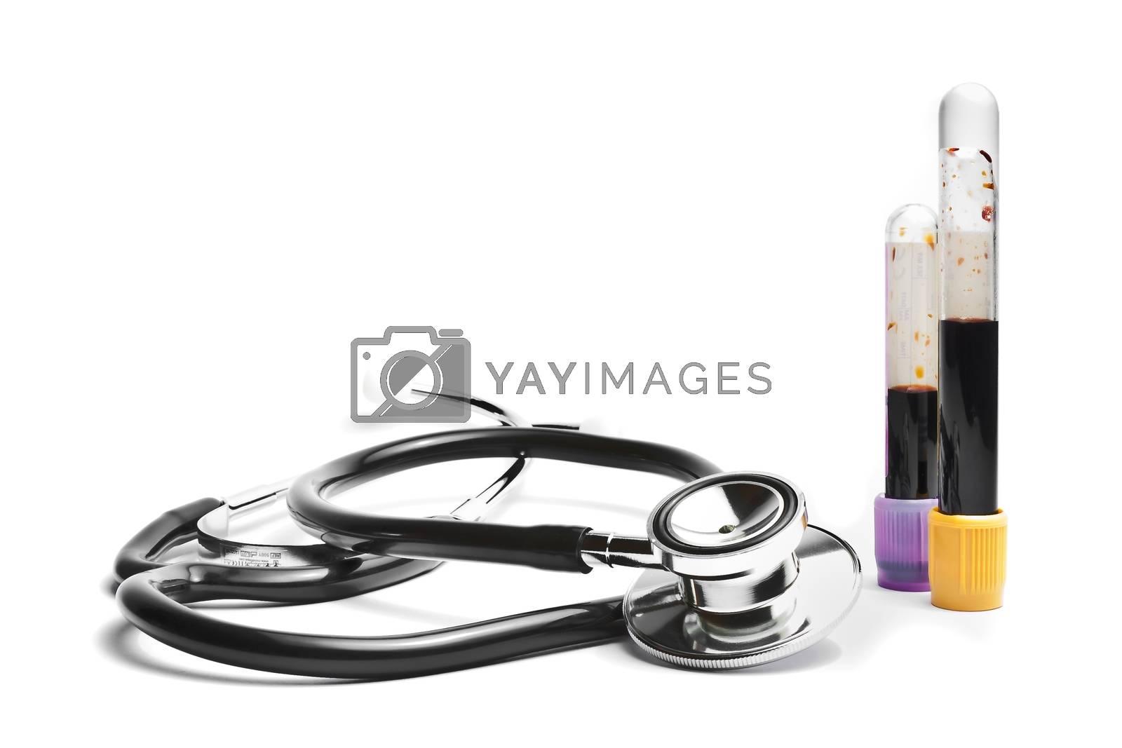 stethoscope near medical tubes on white background