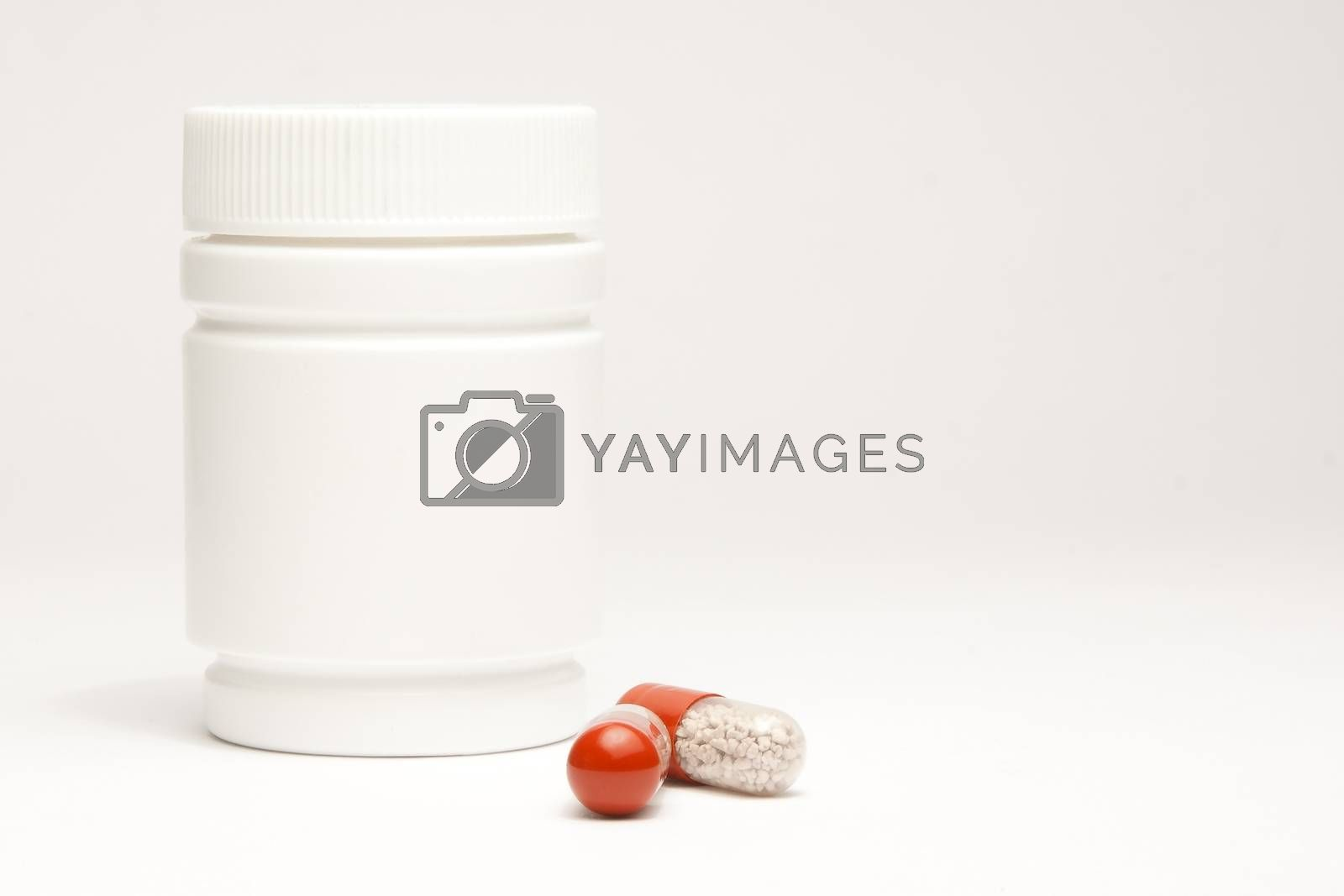 medical pills in laboratory near white container on white table