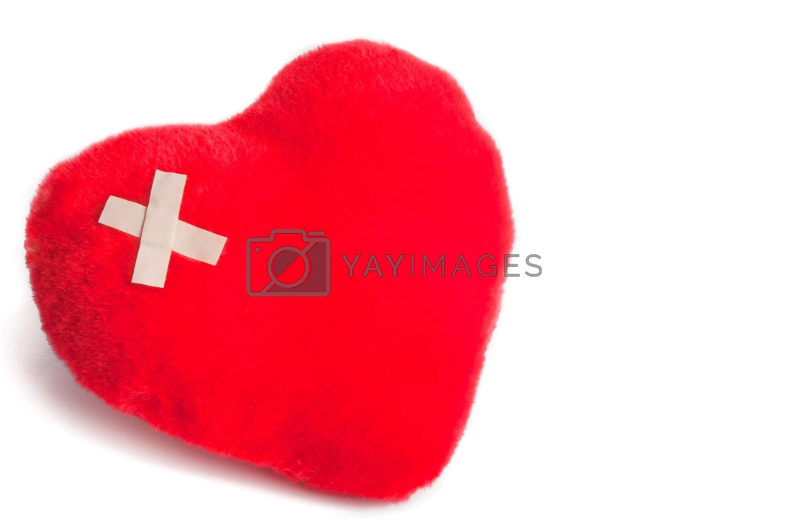 heart of cuddly toys with patch on white background with space for text
