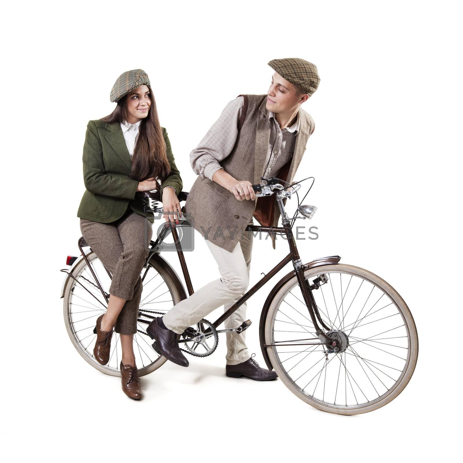 Vintage dressed couple sitting on retro bike