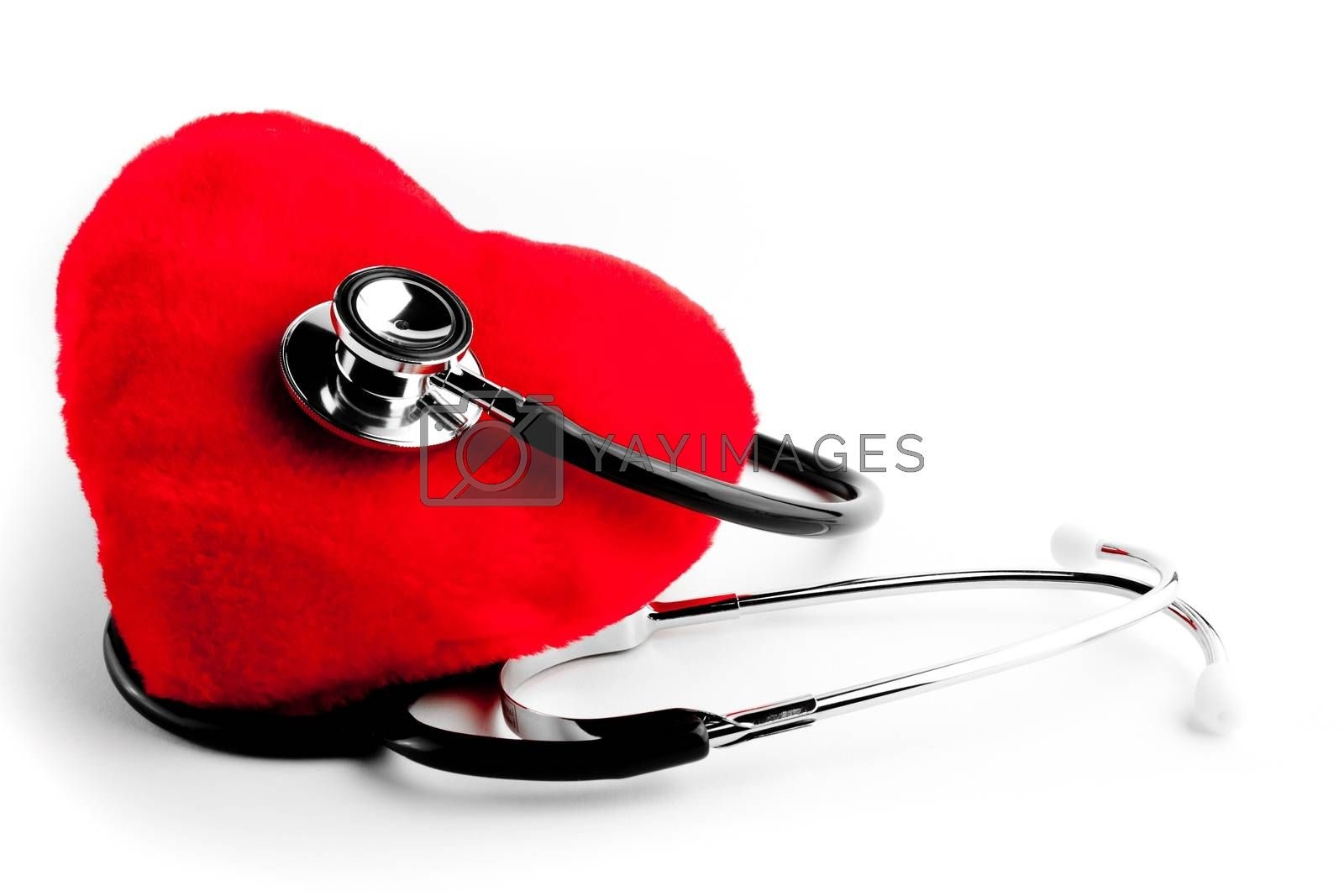 close up of a stethoscope and heart on white background