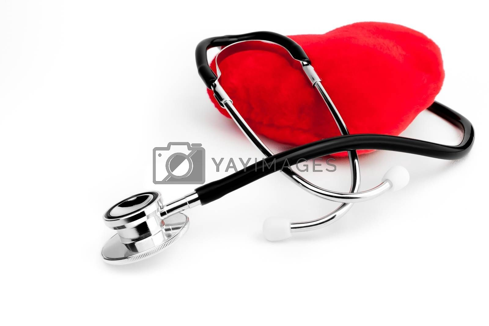 close up of a stethoscope on heart on white background