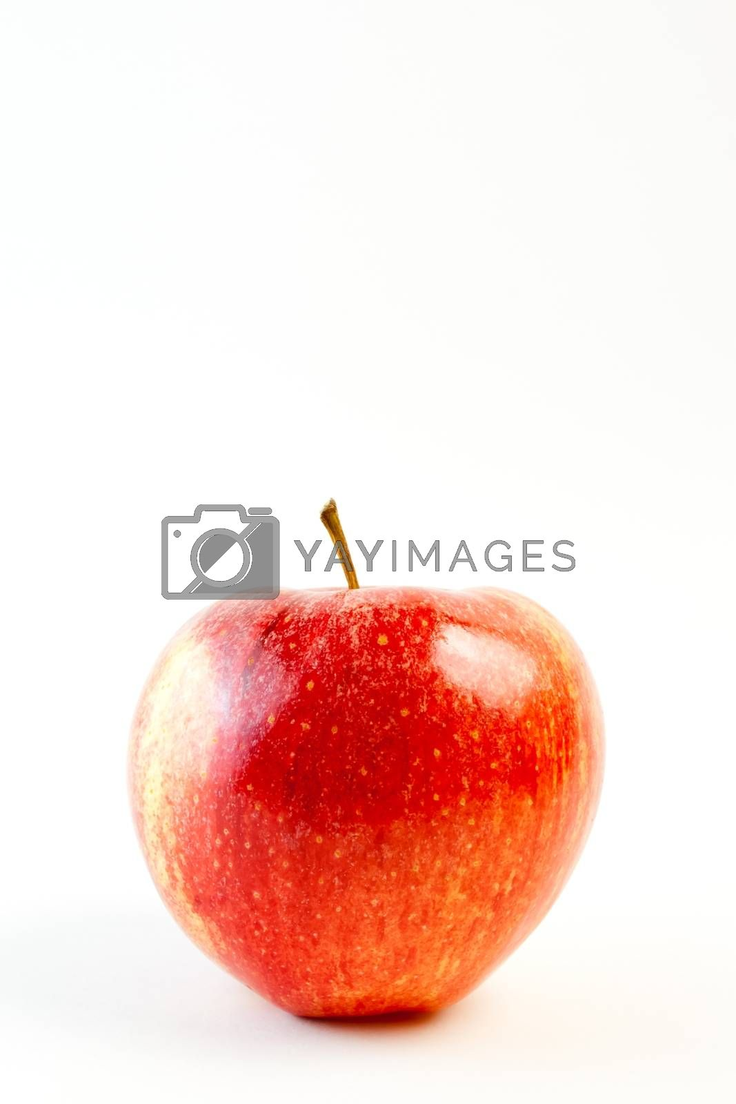 detail of red apple on white background