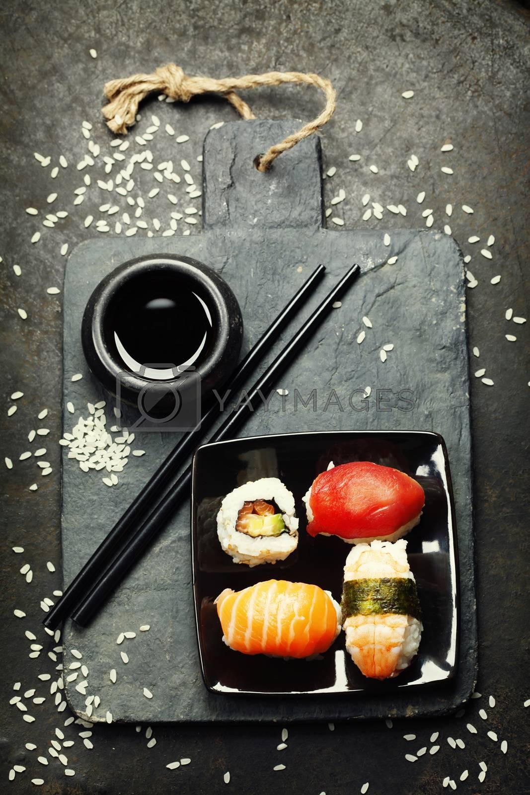 Sushi set on dark vintage background