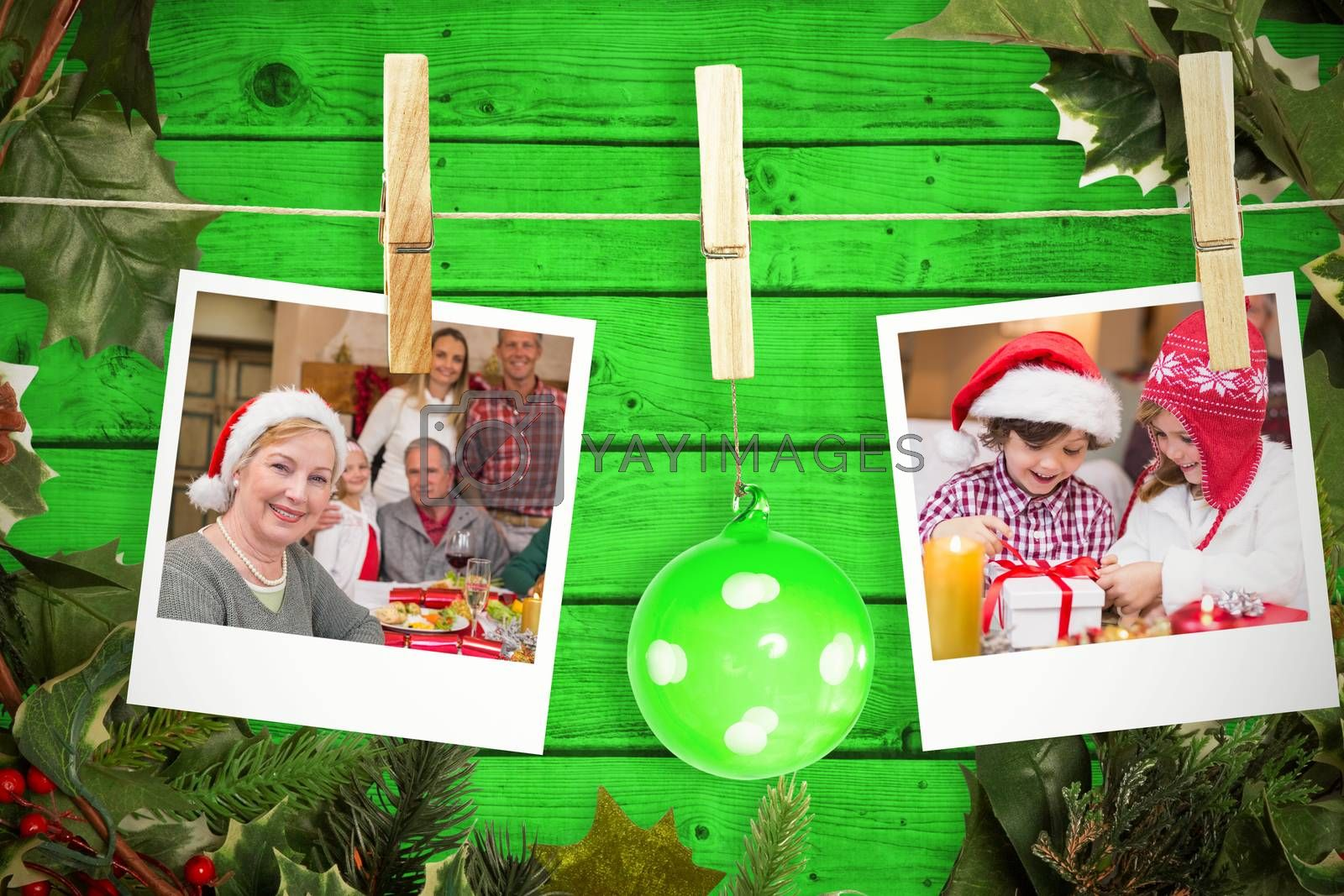 Composite image of hanging christmas photos by Wavebreakmedia