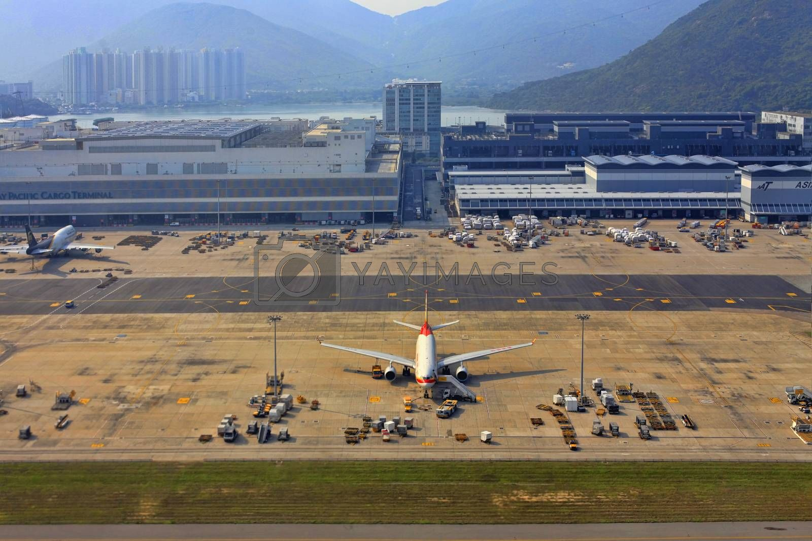 Hong Kong, HKG - APRIL 05, 2014: Cathey Pacific plane ready for boarding in Hong Kong Airport on 05 April 2014. Cathey Pacific was founded in 1946. This company bacome one of the famous airline in Hong Kong