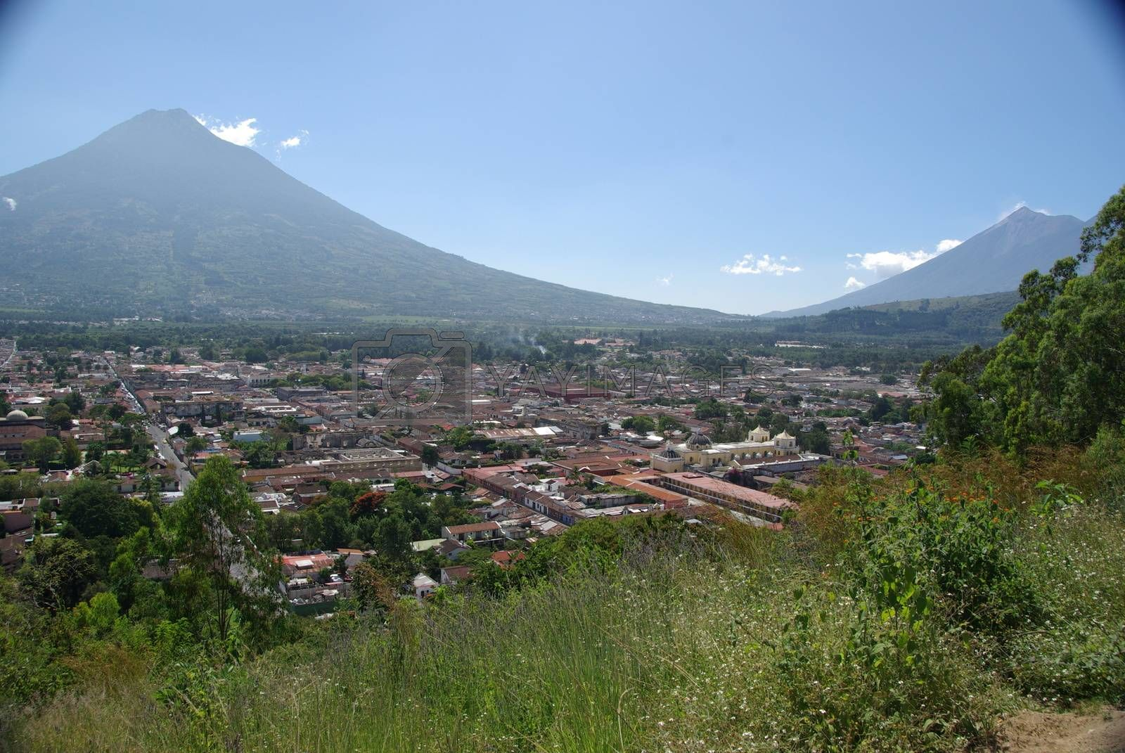 Volcano and the ancient colonial city of Antigua in Guatemala, Central America