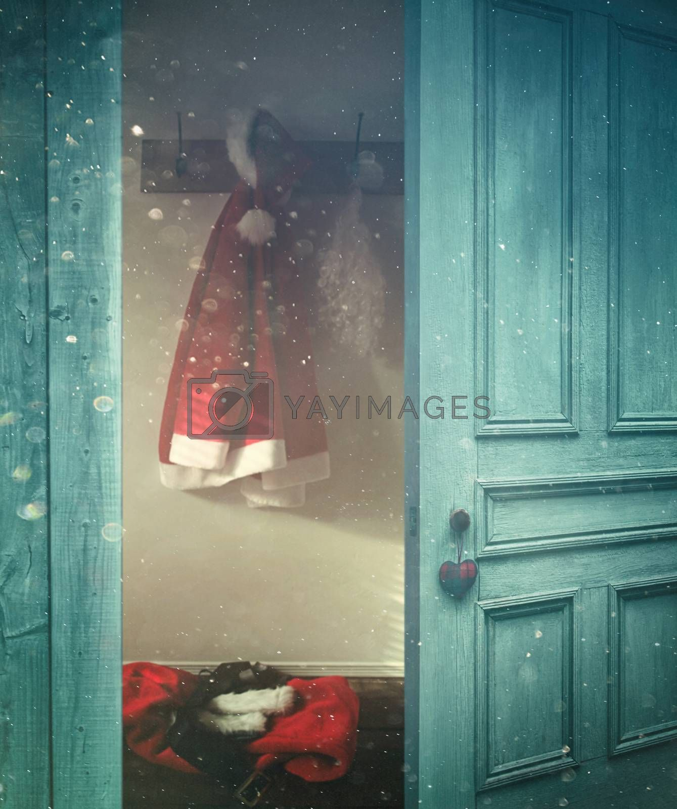 Rustic door opening into a room decorated for Christmas