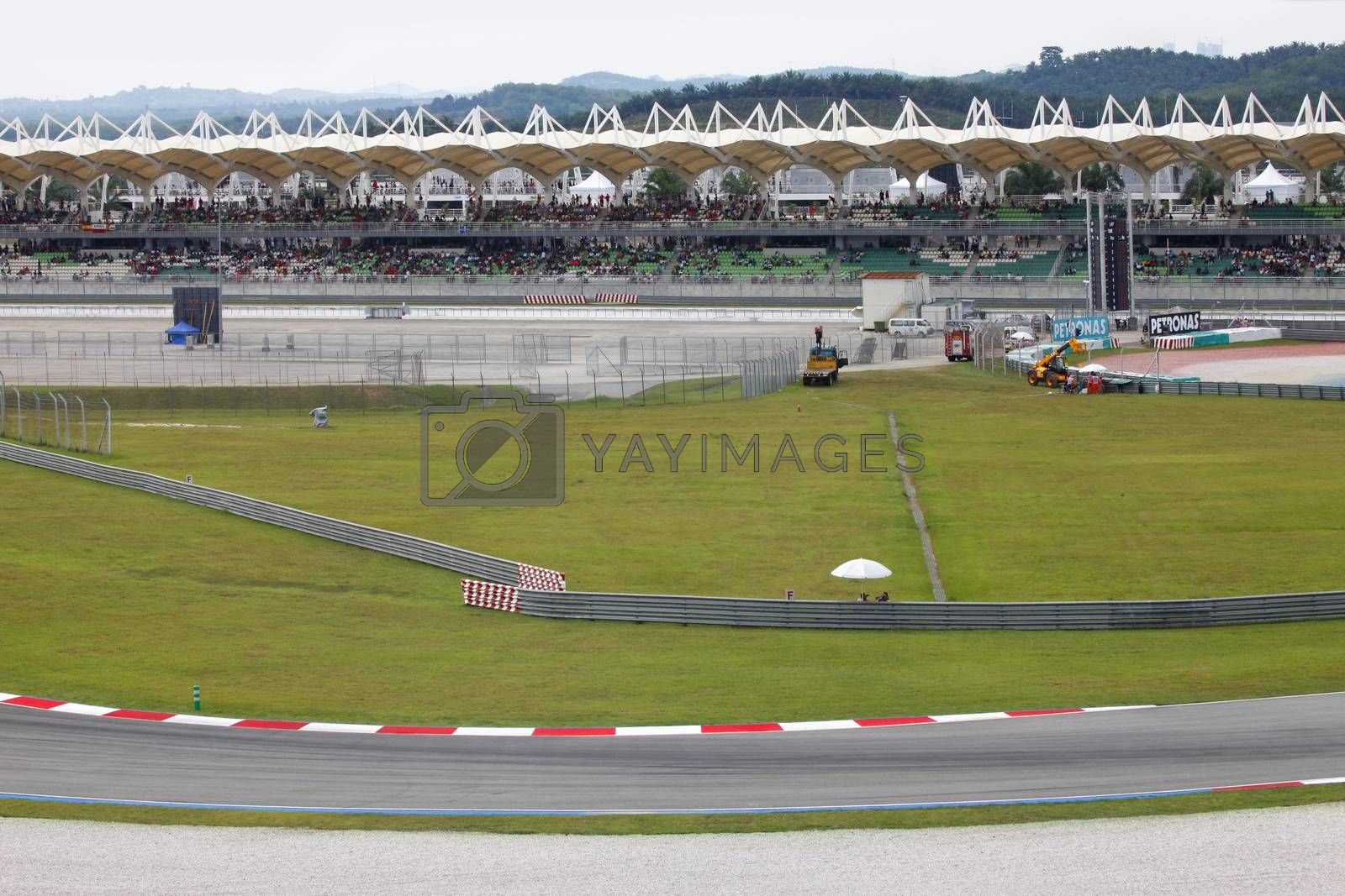 Sepang, Malaysia - April 4, 2010: Stands with people. Malaysian Grand Prix at Sepang F1 first circuit April 4, 2010 in Sepang