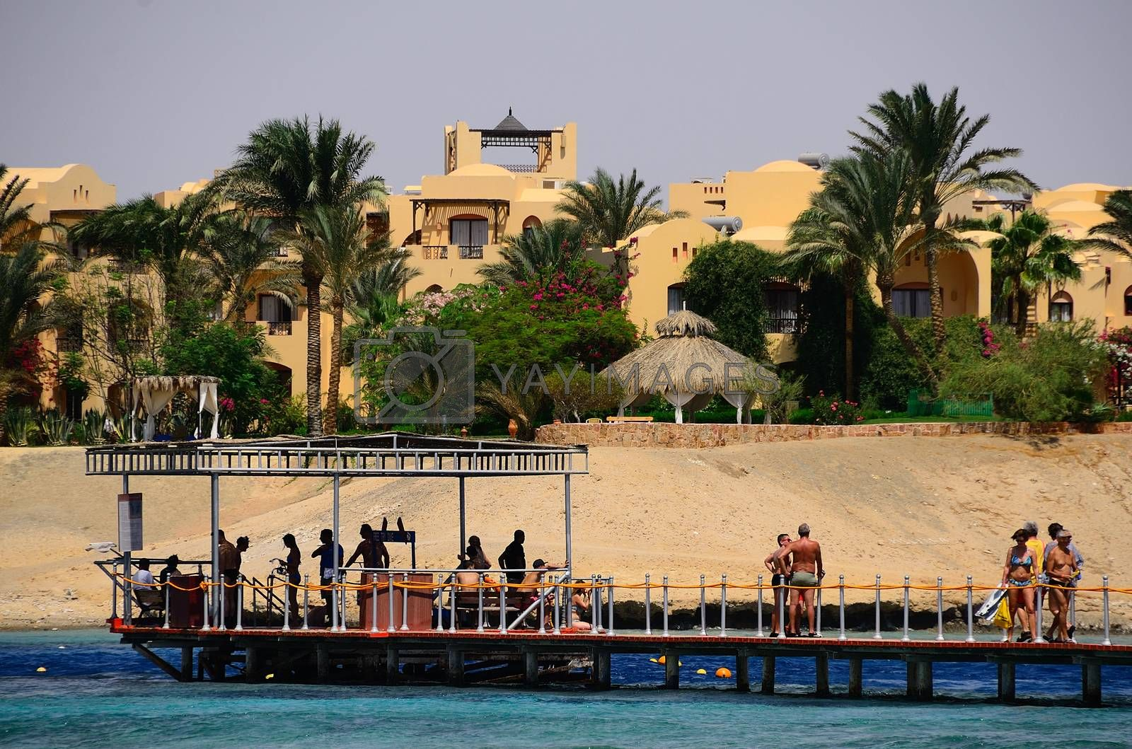 jetty with people on the coral reef in Egypt