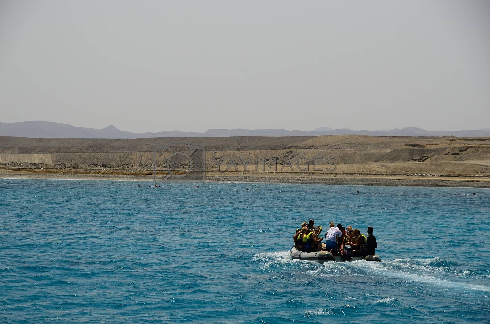 boat and snorkel on the reef in the Red Sea