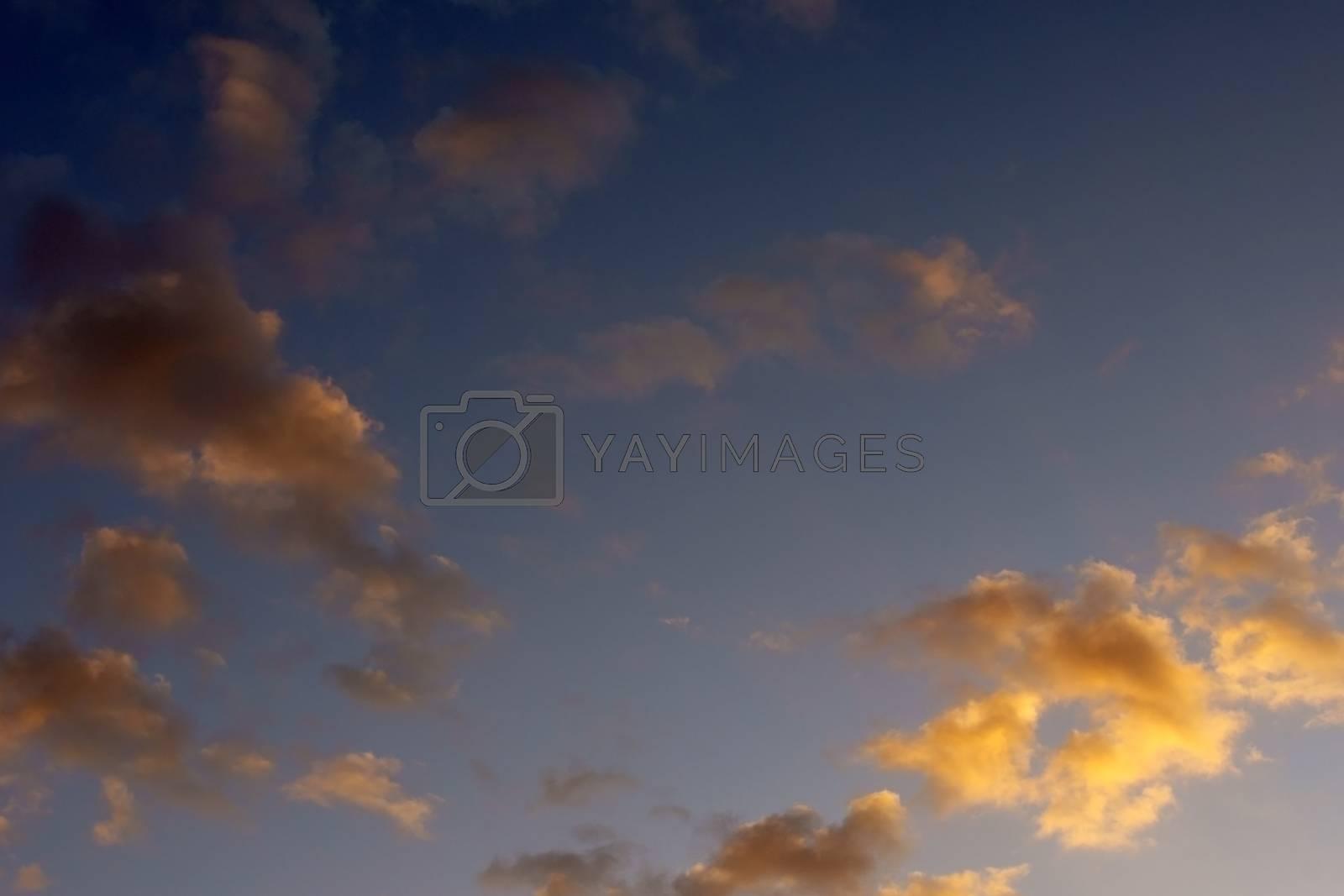 Orange translucent clouds at a sunset.