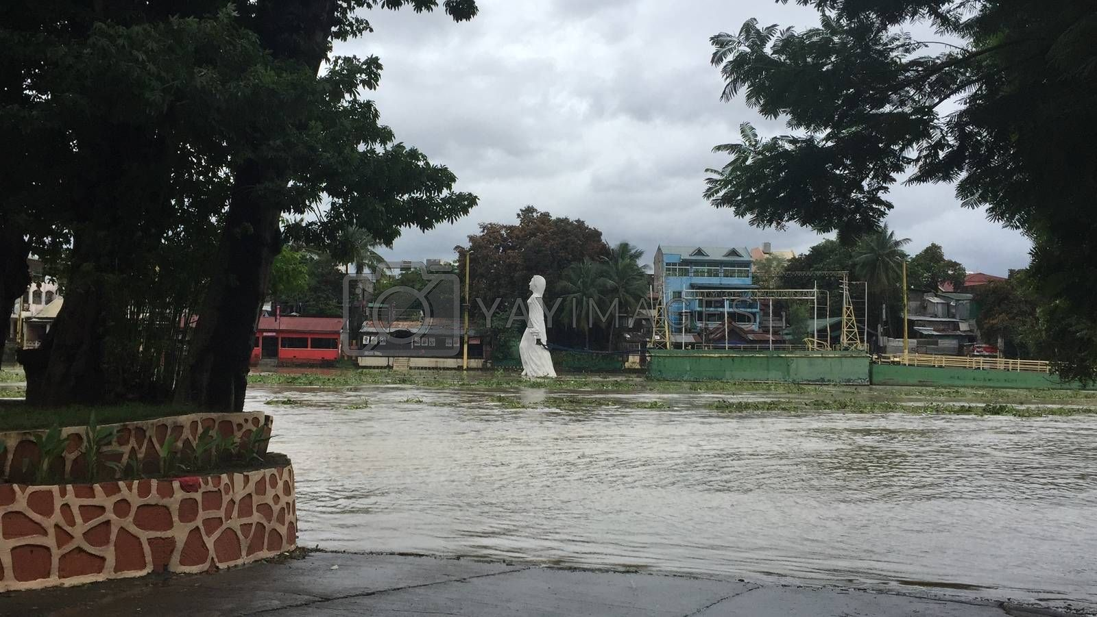 PHILIPPINES, Marikina: Marikina river overflows on October 18, 2015 in Marikina, in Philippines. Heavy rain deepened flood misery in farming and mountainous regions of the northern Philippines October 20, after the latest typhoon to hit the storm-ravaged nation killed at least 22 people.