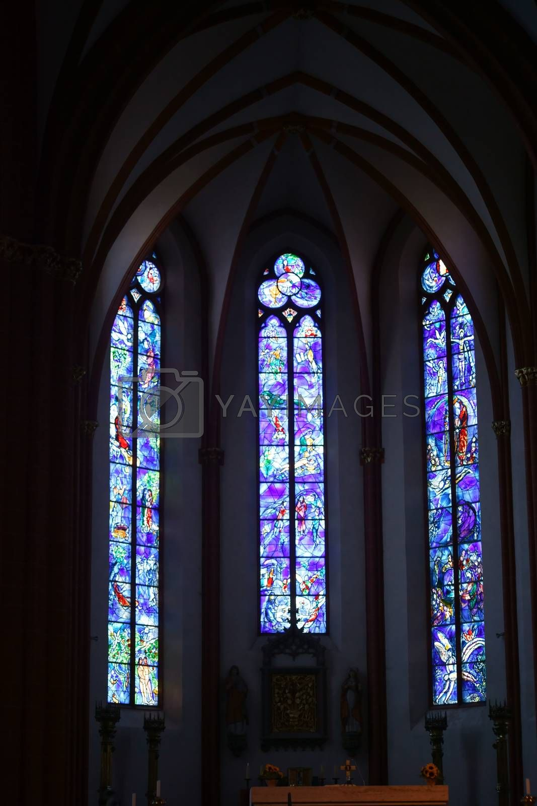 Mainz, Germany - July 10, 2015: The blue painted Chagall windows in the St. Stephen's Church on an altar on July 10, 2015 in Mainz.