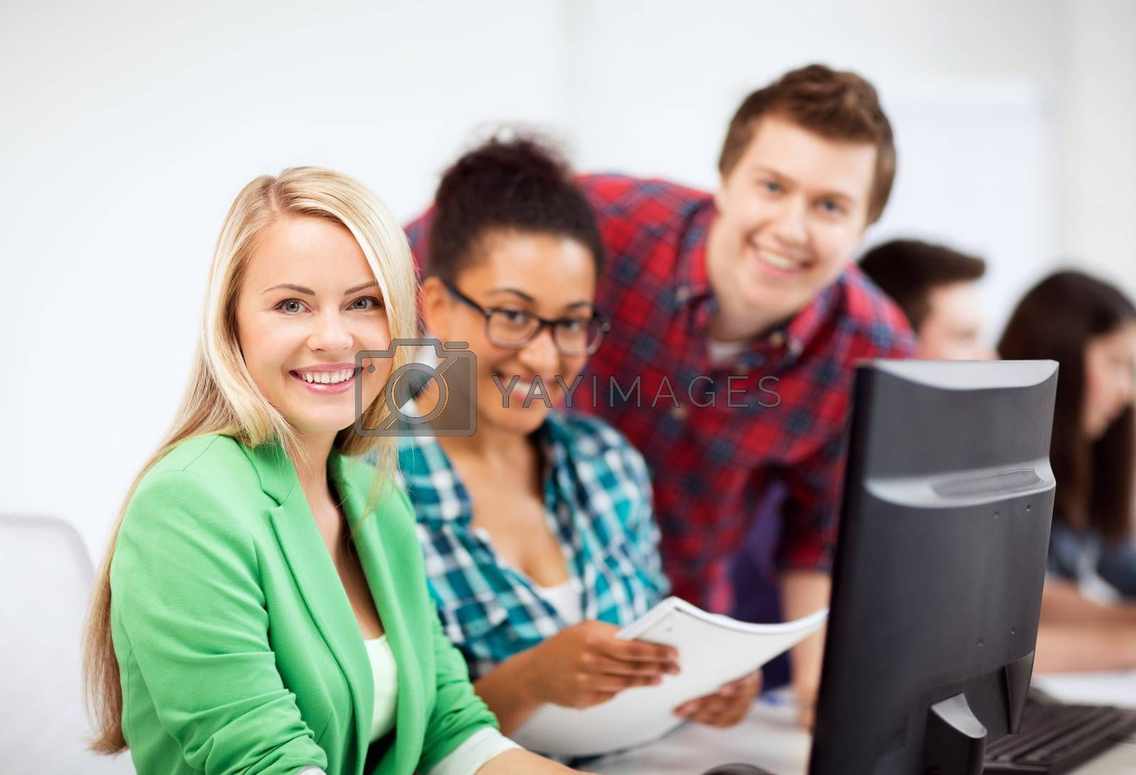 education, technology and internet - students with computer studying at school