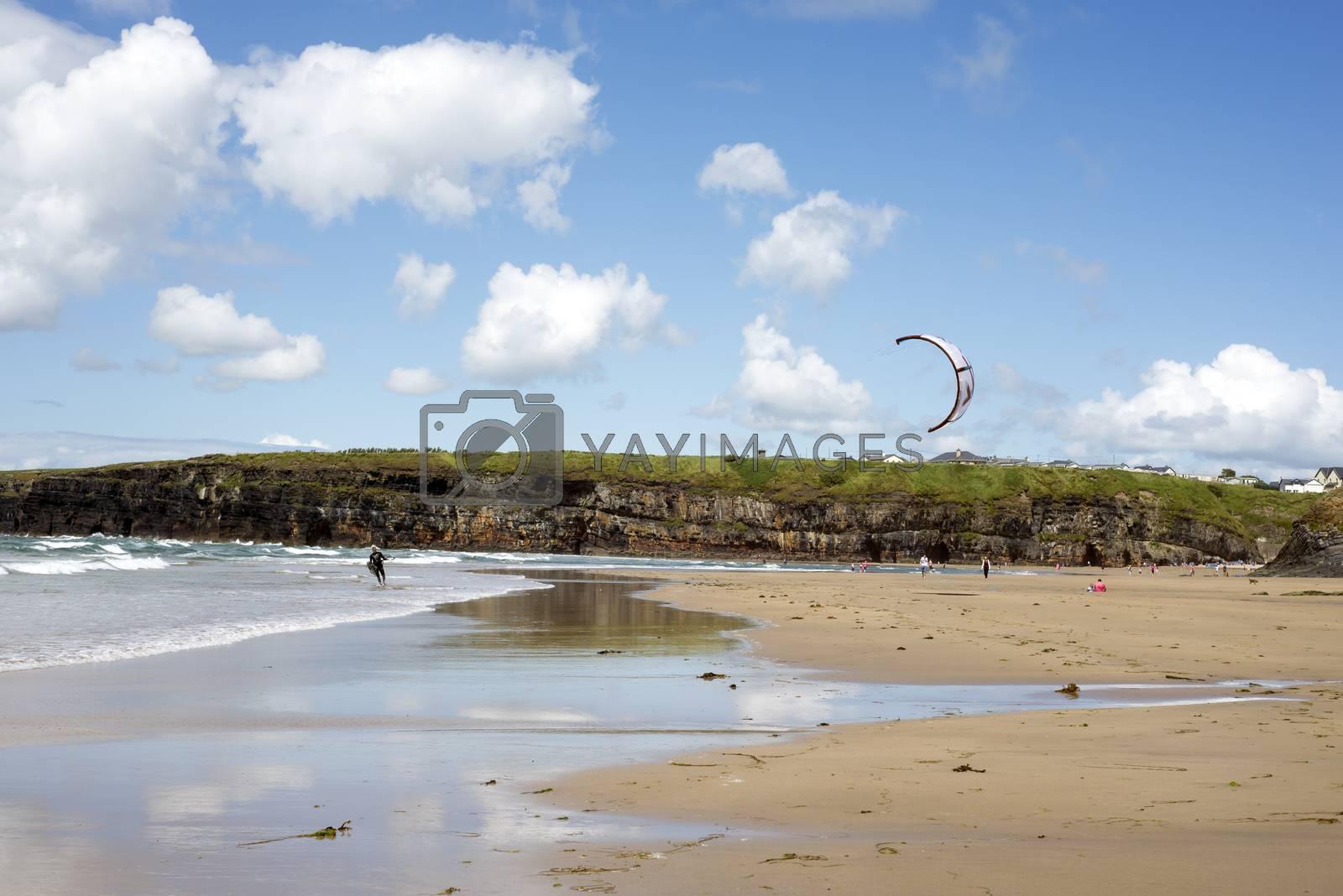 lone kite surfer getting ready at ballybunion beach on the wild atlantic way