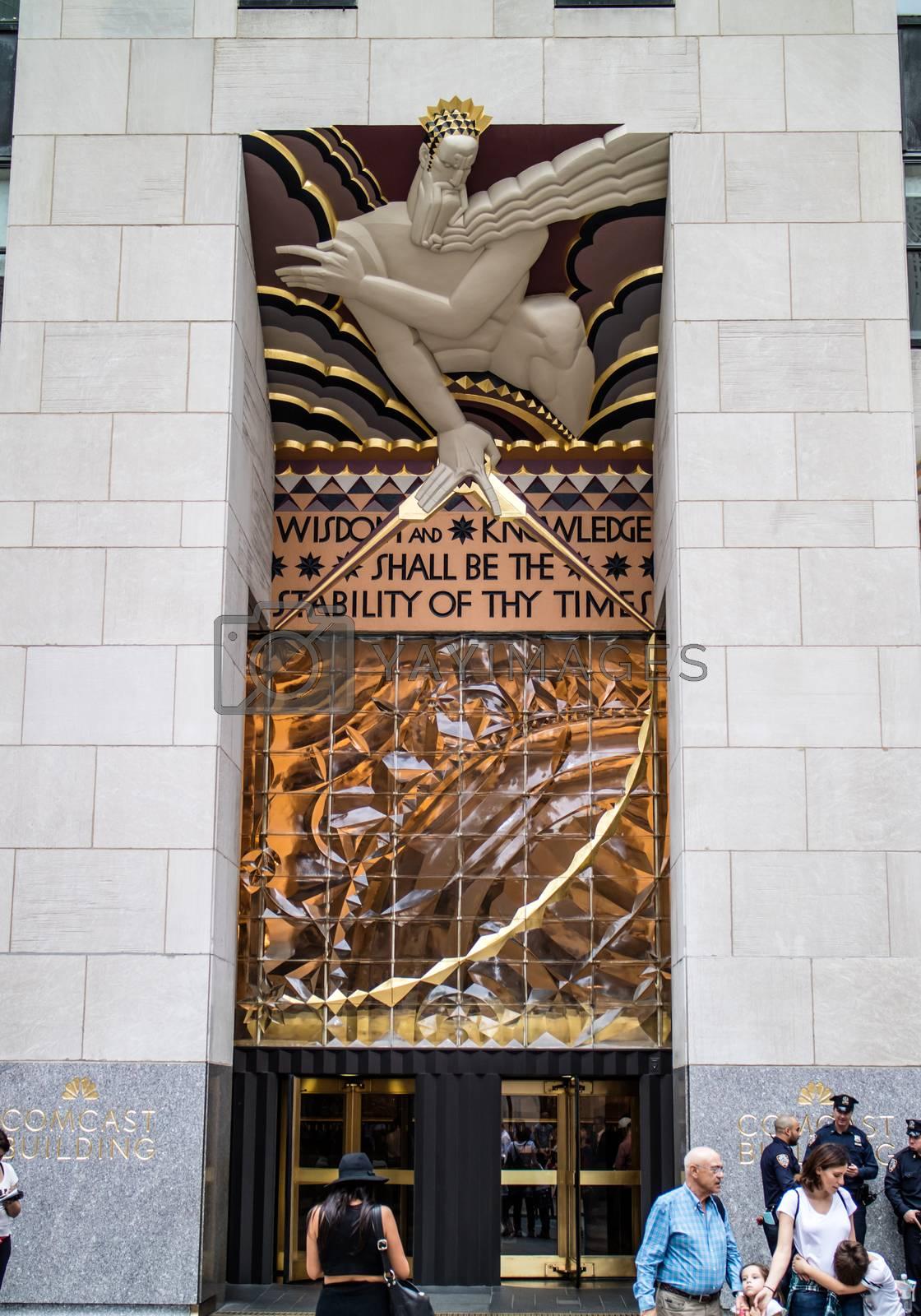 NEW YORK, USA, October 10, 2015: Unidentified people walking in front of Rockfeller Center building in Manhattan, New York.