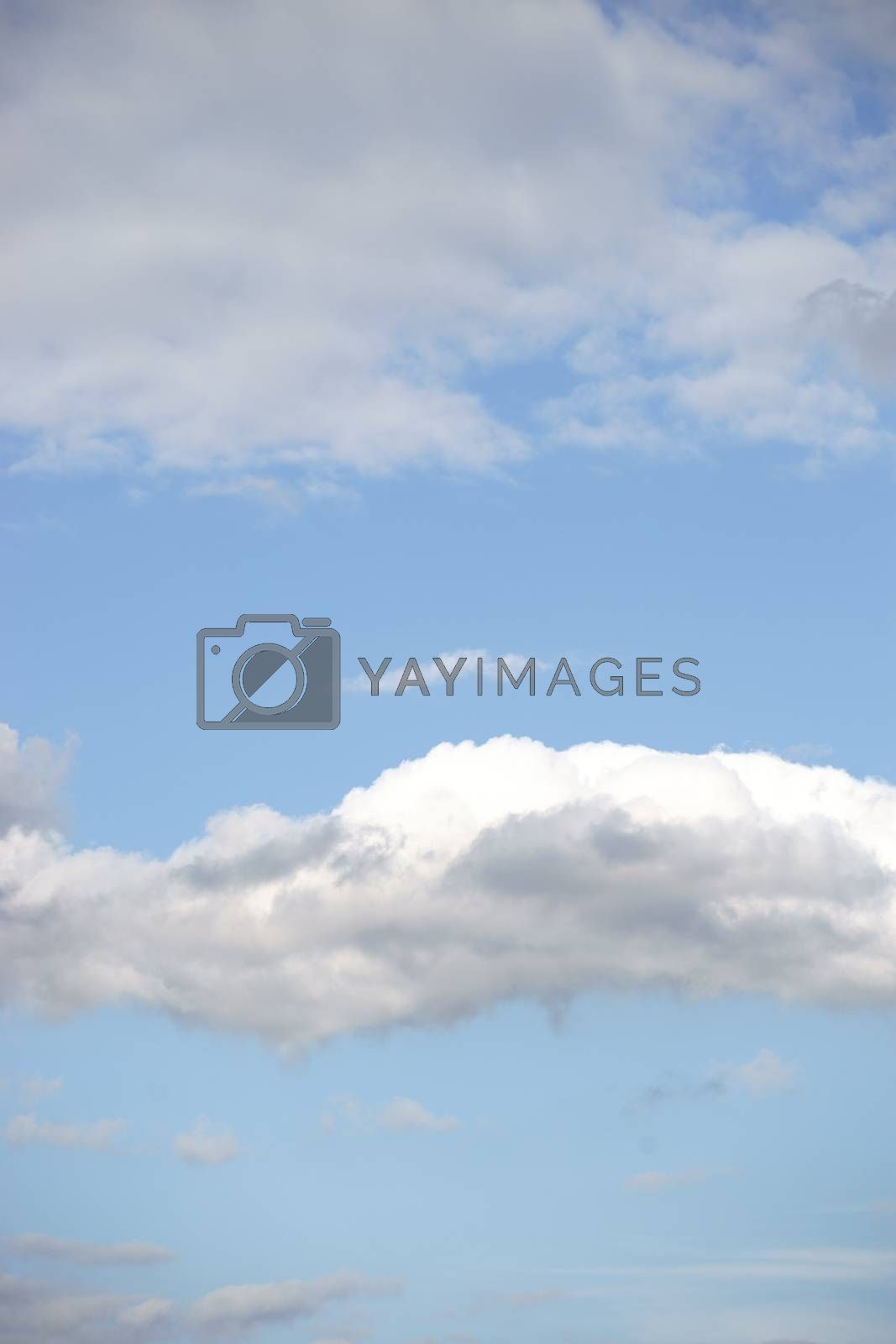 A beautiful light blue sky with white clouds.