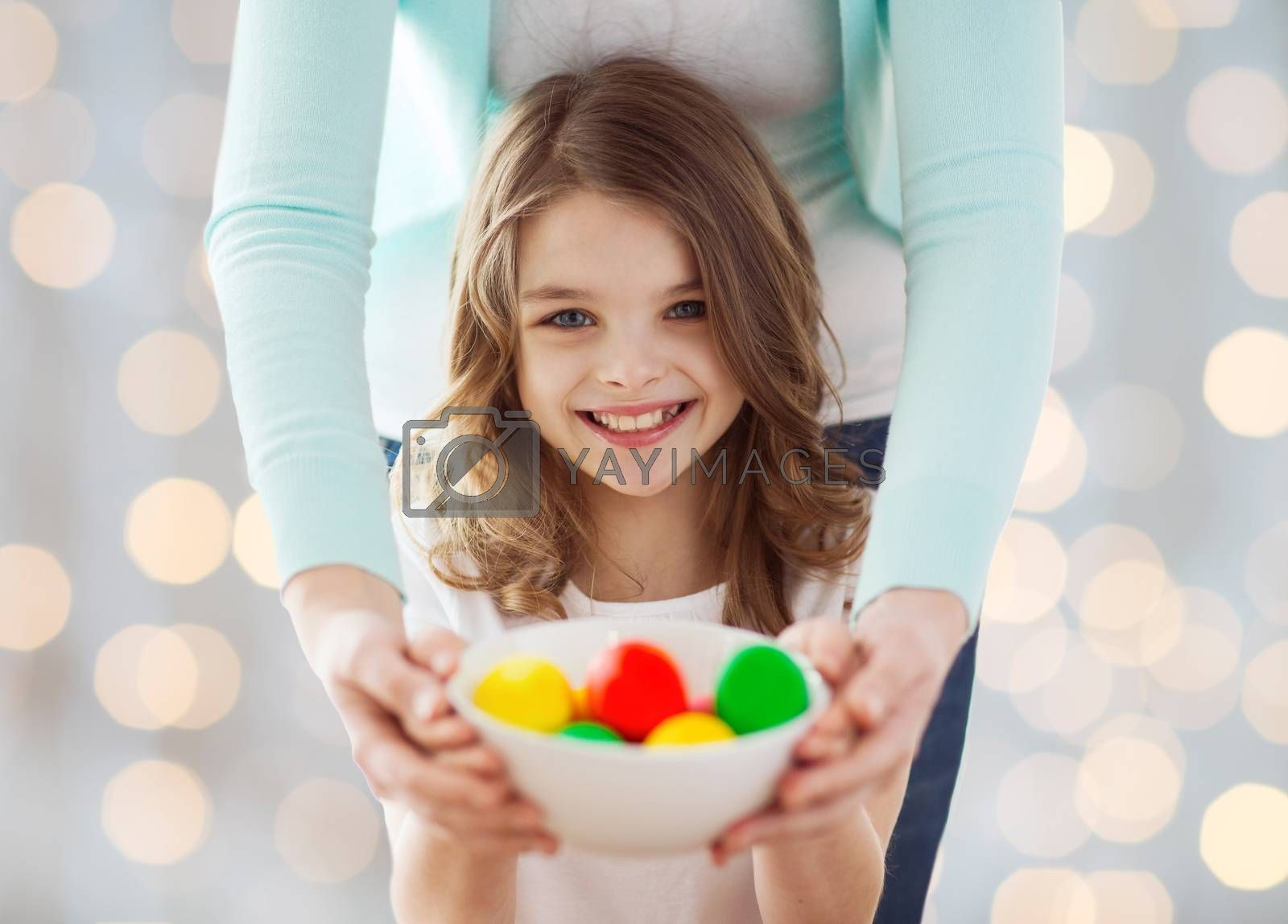 Royalty free image of close up of happy family holding easter eggs by dolgachov