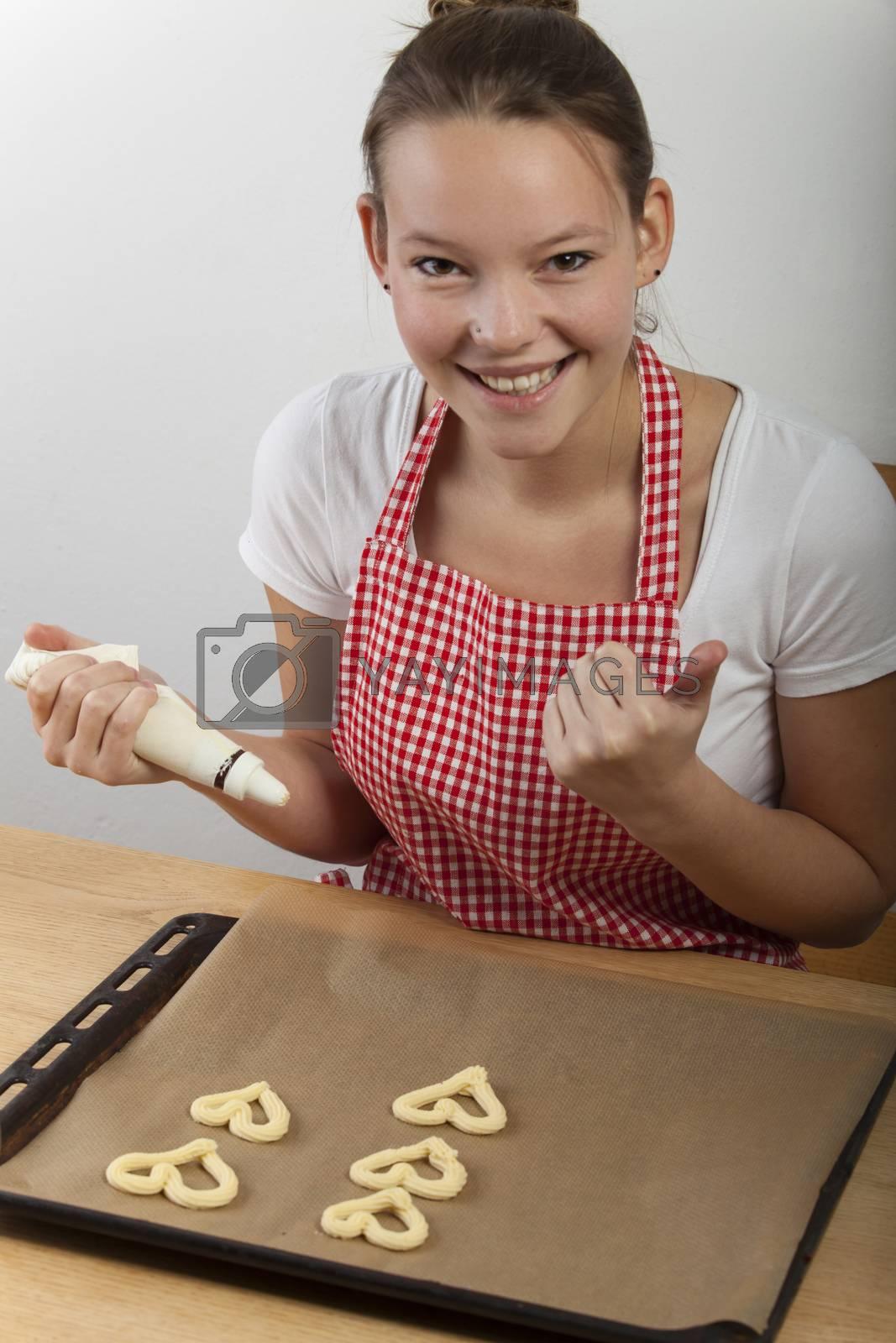 woman baking cookies  by bernjuer