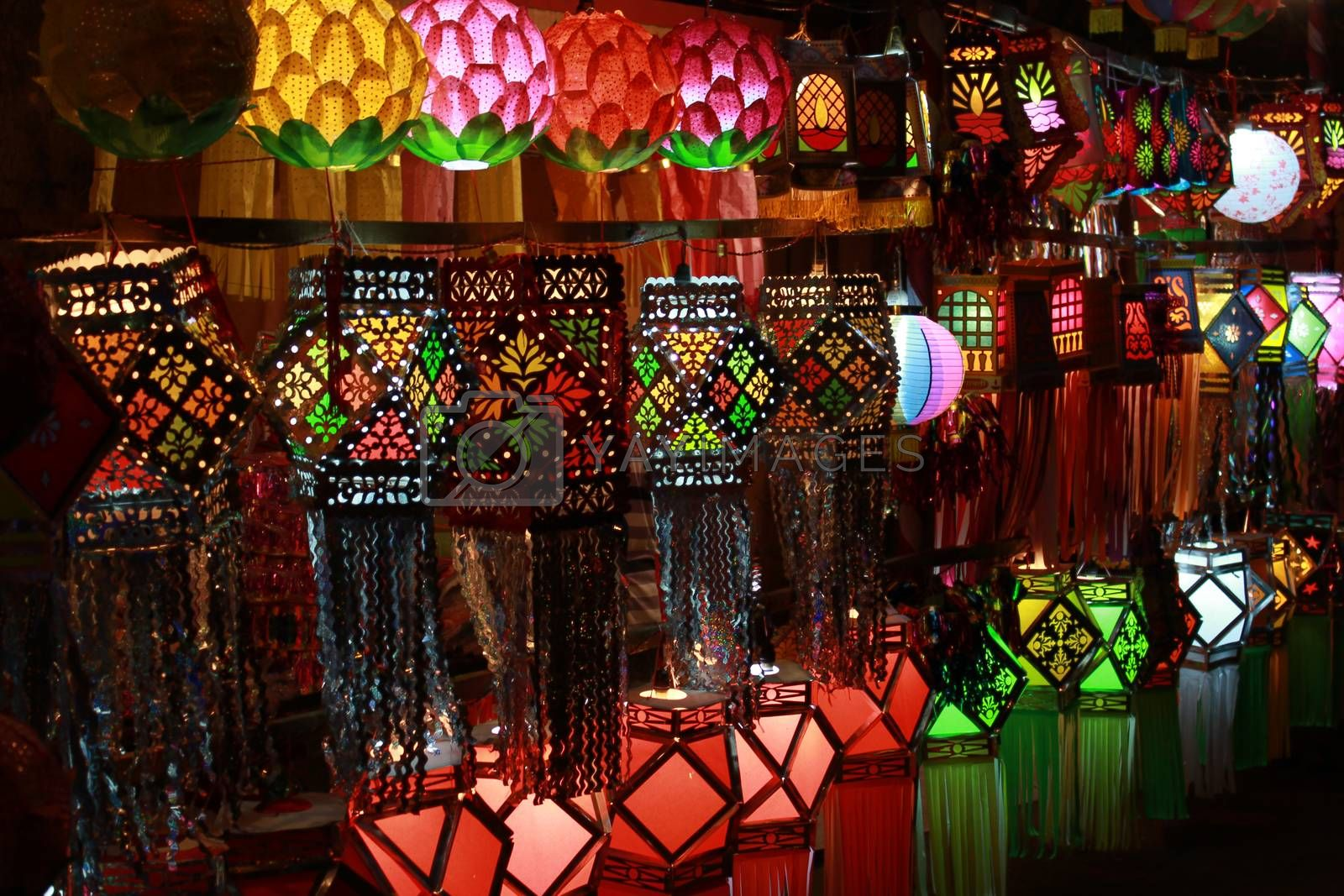 A streetside shop in India displaying different traditional and modern sky lanterns to be used traditionally for Diwali festival in India.
