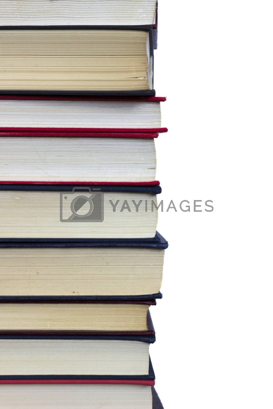 Stack of books on white background, partial view