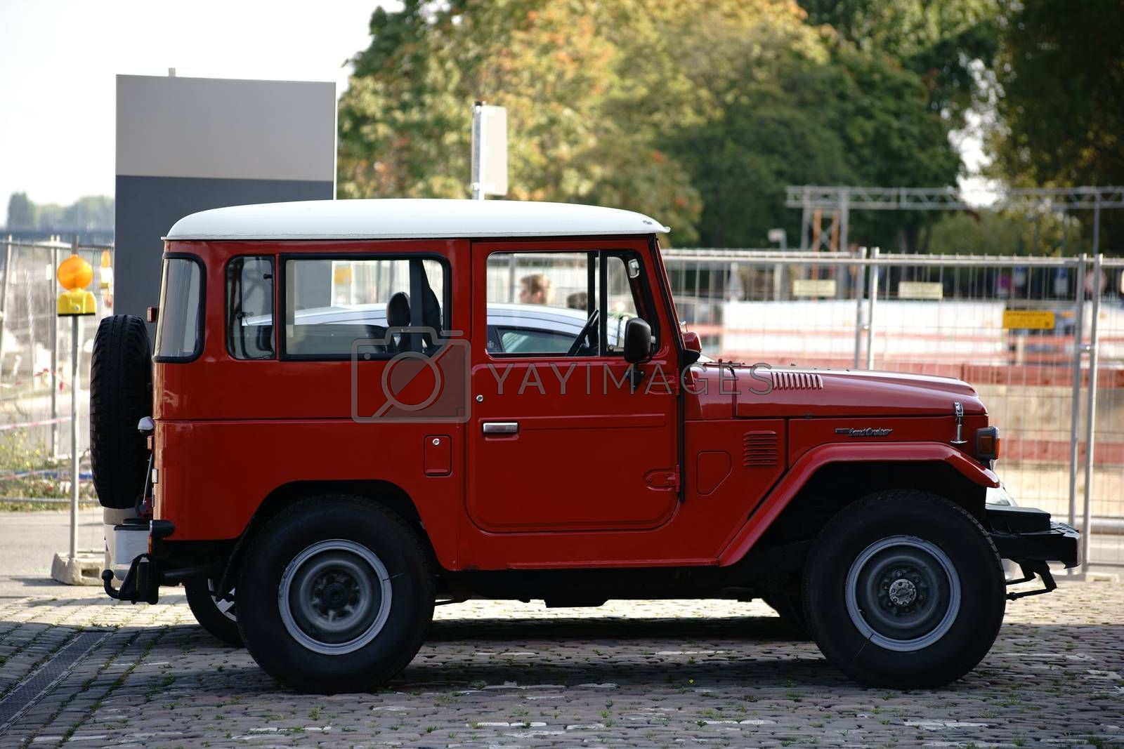 Mainz, Germany - October 2, 2015: The side view of a red SUV from the brand Toyota Land Cruiser on October 02, 2015 in Mainz.